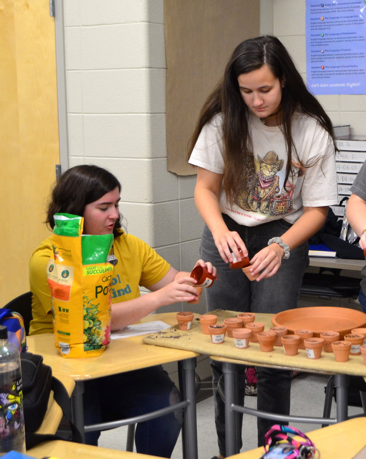Jasper High School students work to plant seeds at a meeting of the new Viking Victory Garden Club on Friday.