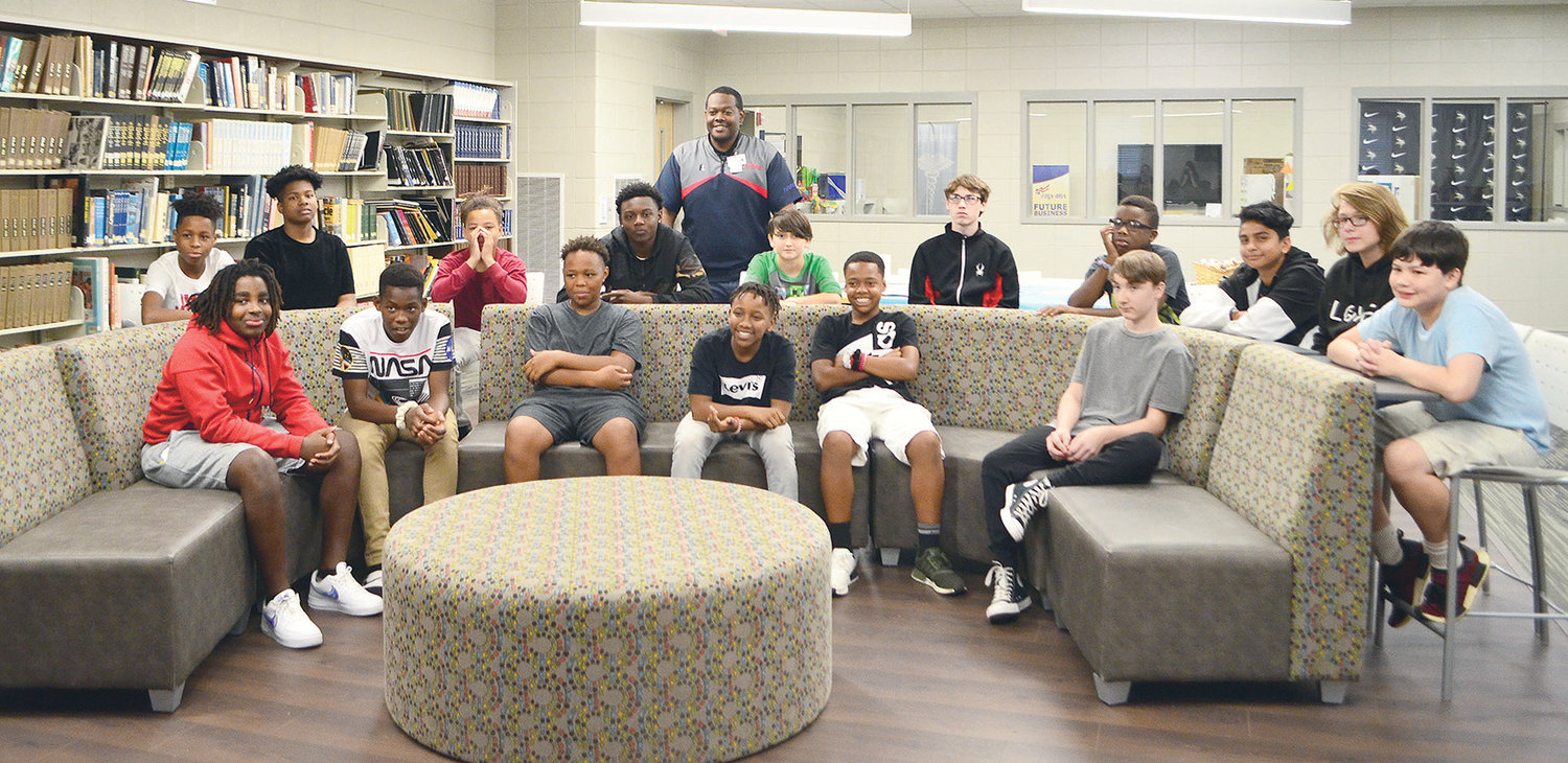 Principal Lutis Moore, center, is pictured with members of Jasper Jr. High School's JUMP Club for teen boys. The club teaches leadership skills and provides service-learning opportunities.