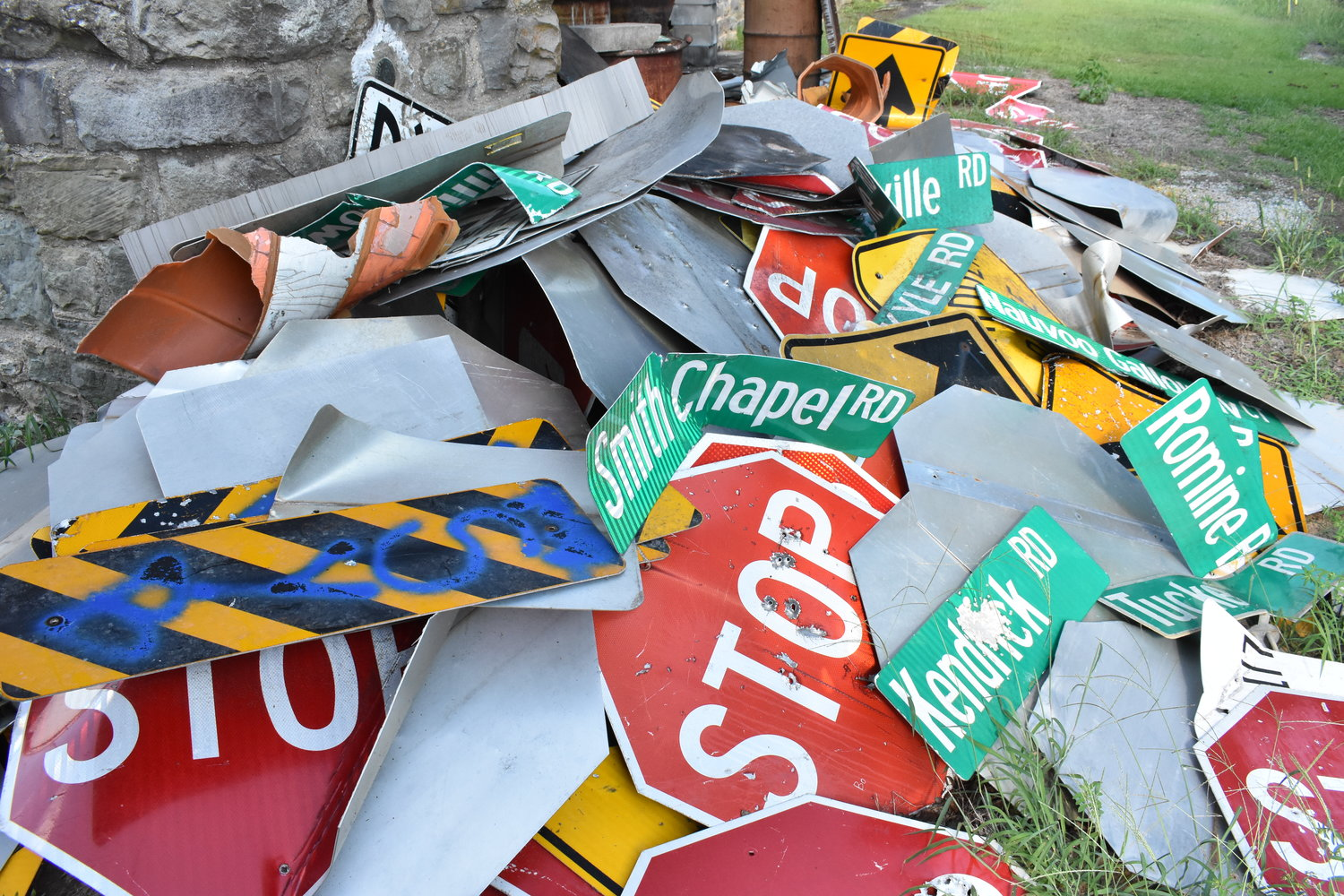 These street signs, stored behind the Road and Bridge Department building in Jasper, represent stolen and vandalized county road signs that have been recovered. Walker County officials say the constant theft and vandalism is costly to the county, and dangerous to residents.