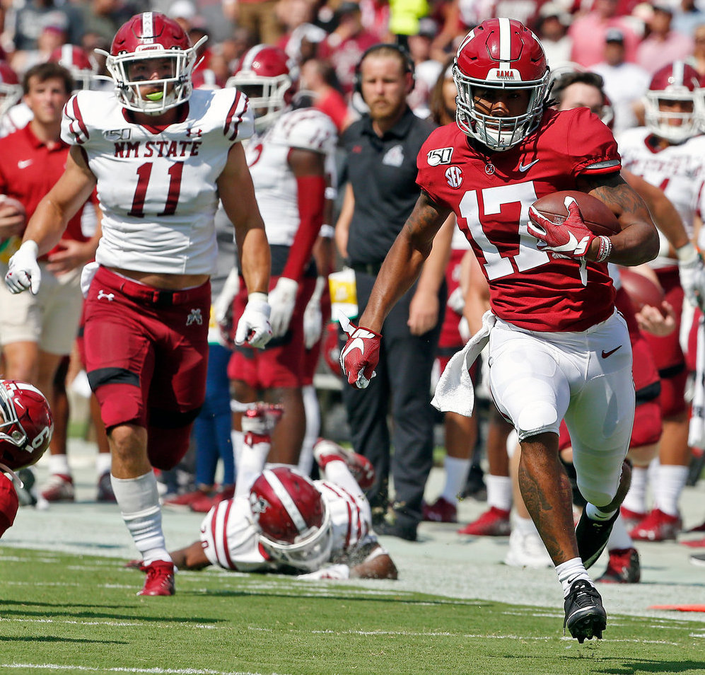Alabama defensive back Patrick Surtain II (2) leaps to make an interception in front of New Mexico State receiver Tony Nicholson (13) during Saturday's game at Bryant-Denny Stadium in Tuscaloosa. Alabama won 62-10.
