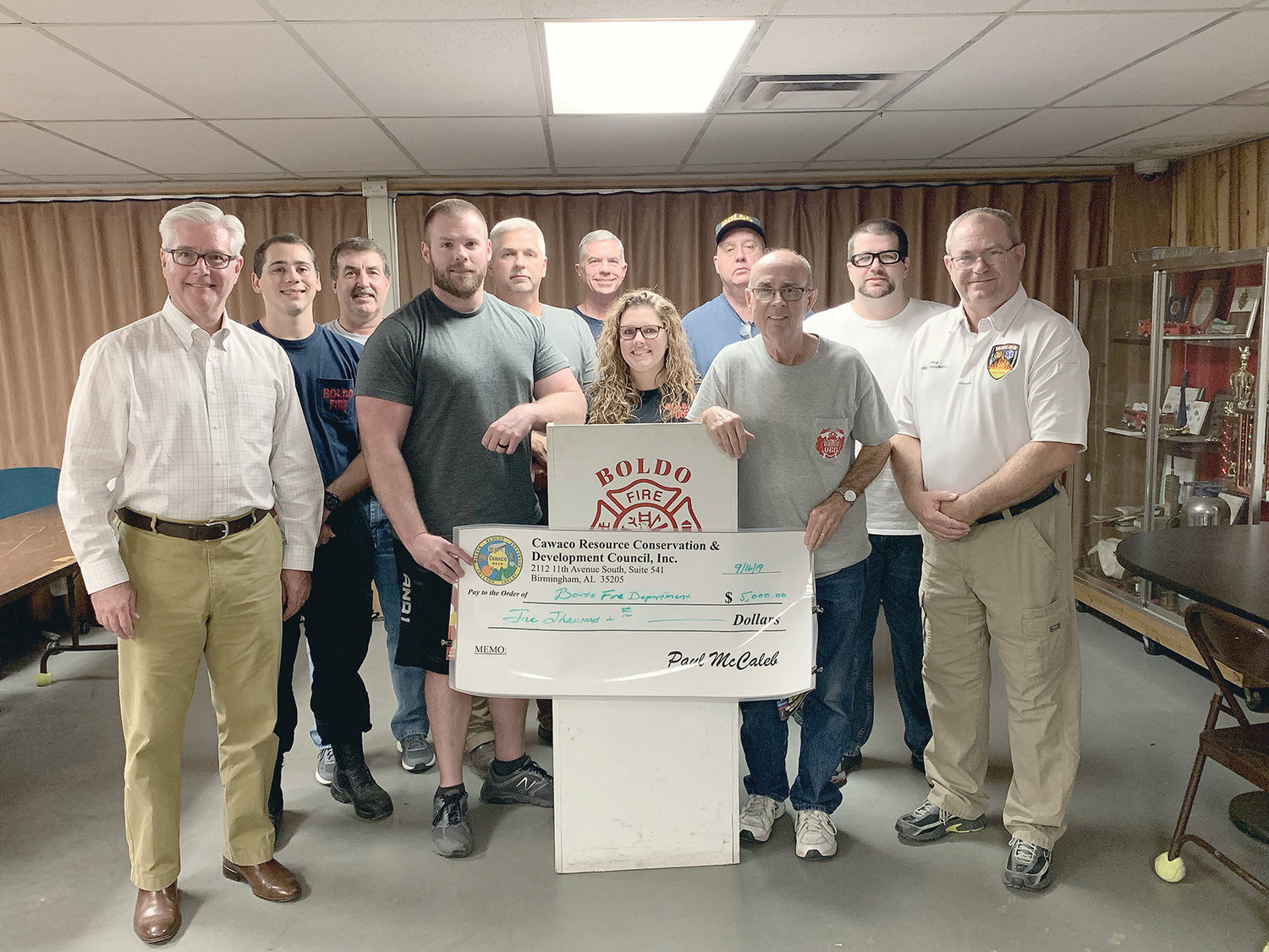 Senate Majority Leader Greg Reed, R-Jasper, presented a check Monday to Boldo Fire for $5,000 for a new generator. The grant came from the Cawaco Resource, Conservation & Development Council. Shown are, from left, Reed, Landon Lilley, Ronnie Gravlee, Jason Hardin, Mike Knowles, Richard Fikes, Amie Gravlee, Steve Dutton, Sam Carroll, Justin Knowles, and Boldo Fire Chief Greg Chamness.