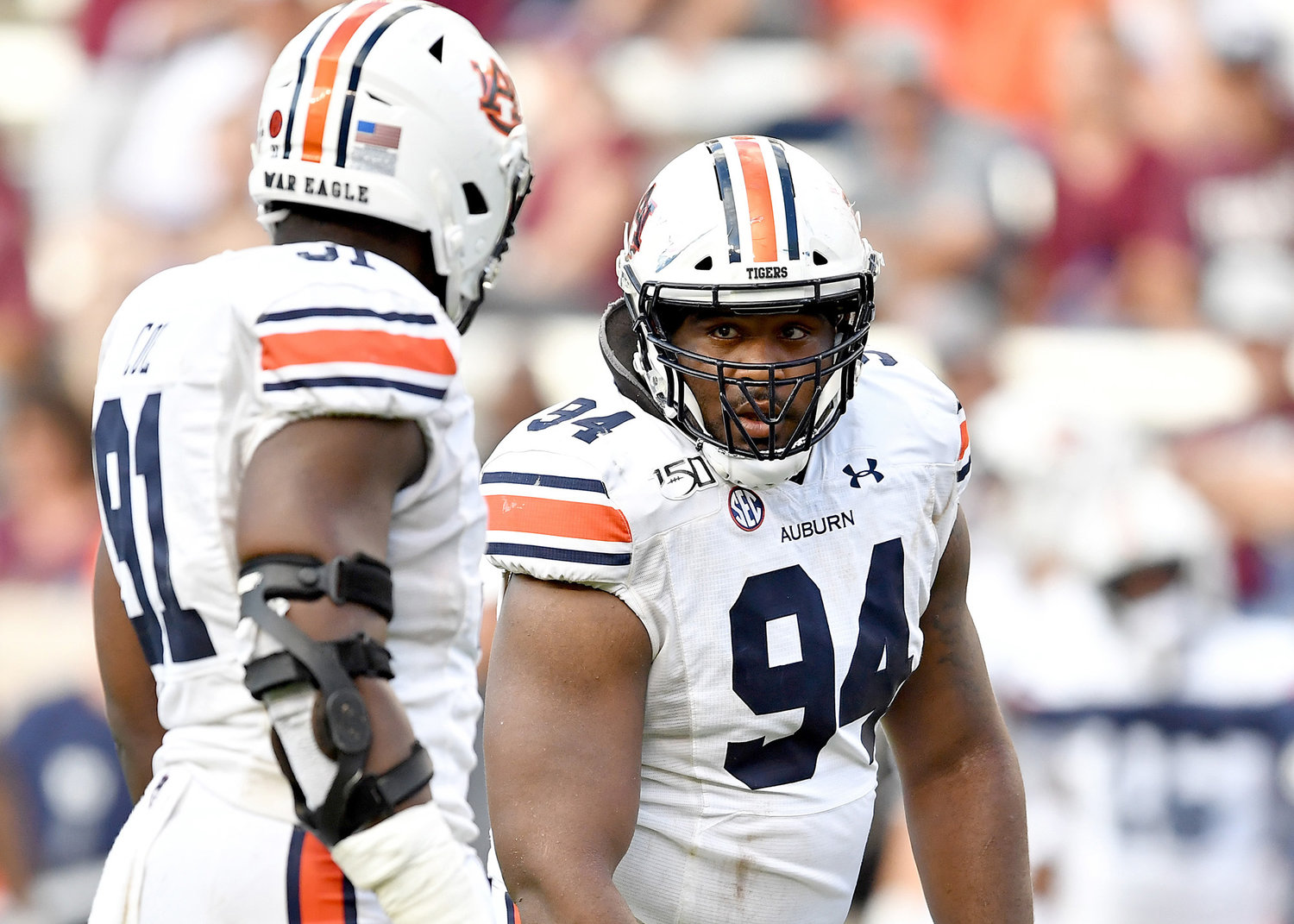 Auburn Tigers defensive tackle Tyrone Truesdell (94) and defensive end Nick Coe (91) discuss strategy during the second half of an NCAA football game Saturday, Sept. 21, 2019, at Kyle Field in College Station Texas. Auburn wins 28-20.