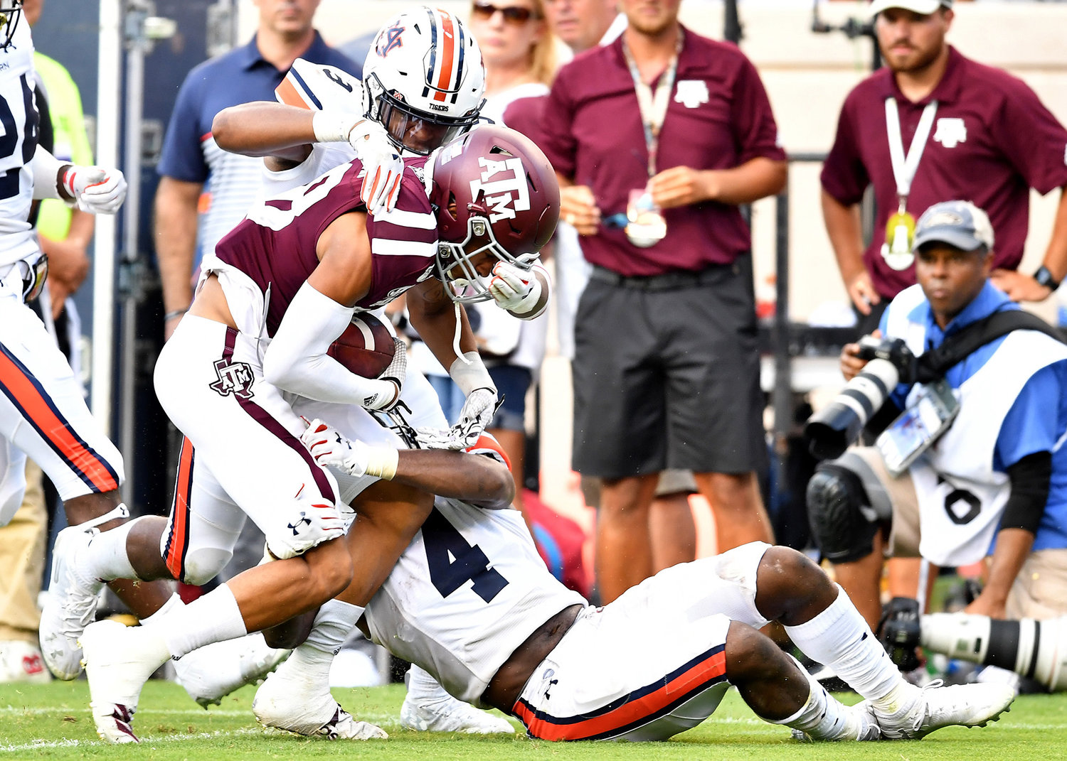 Auburn Tigers defensive back Javaris Davis (13) causes a fumble during a Texas A&M Aggies kickoff return in the fourth quarter of an NCAA football game Saturday, Sept. 21, 2019, at Kyle Field in College Station Texas. Auburn wins 28-20.
