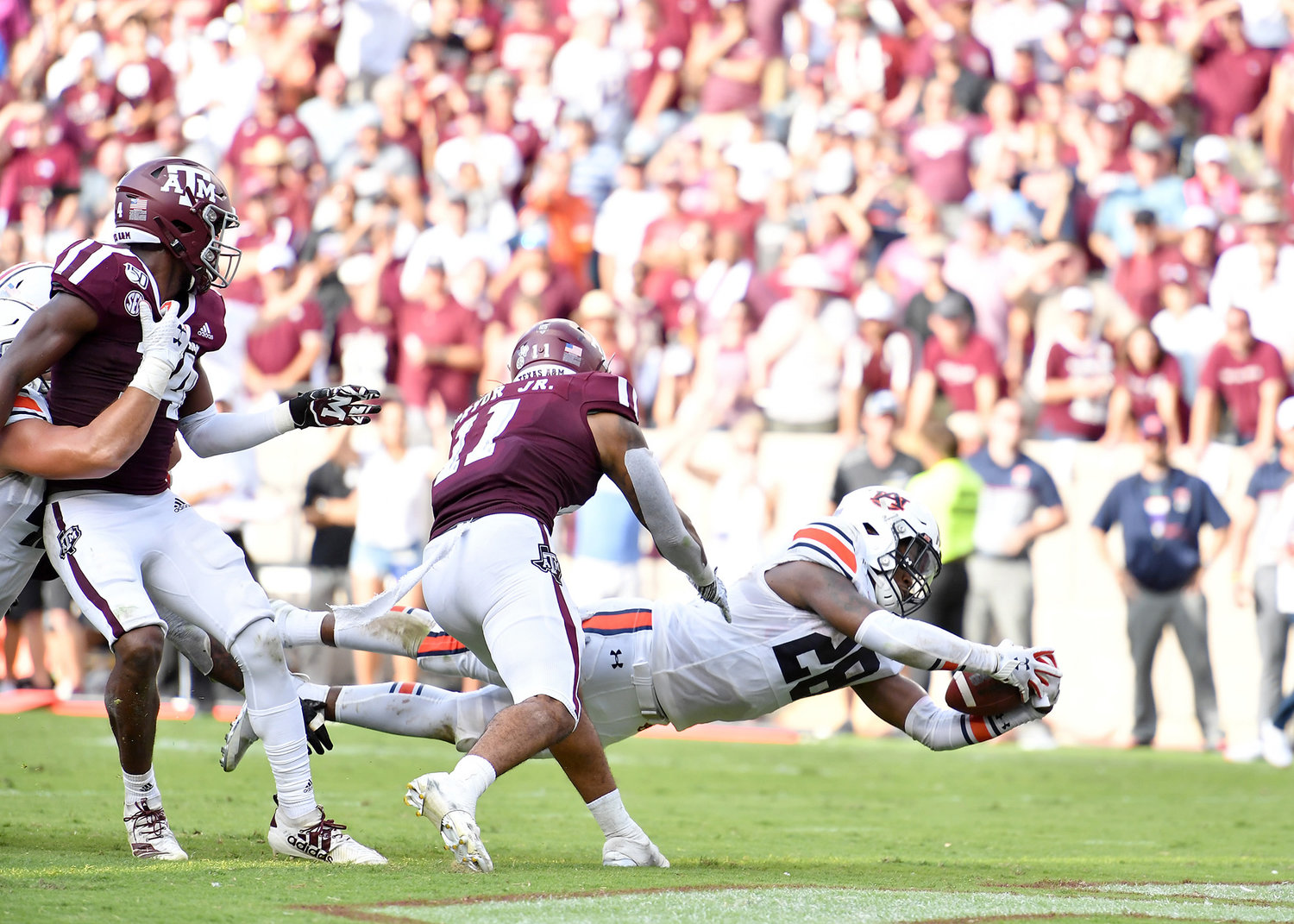 Auburn Tigers running back JaTarvious Whitlow (28) dives for the endzone and the fourth touchdown of the day during the second half of an NCAA football game against the Texas A&M Aggies Saturday, Sept. 21, 2019, at Kyle Field in College Station Texas. Auburn wins 28-20.