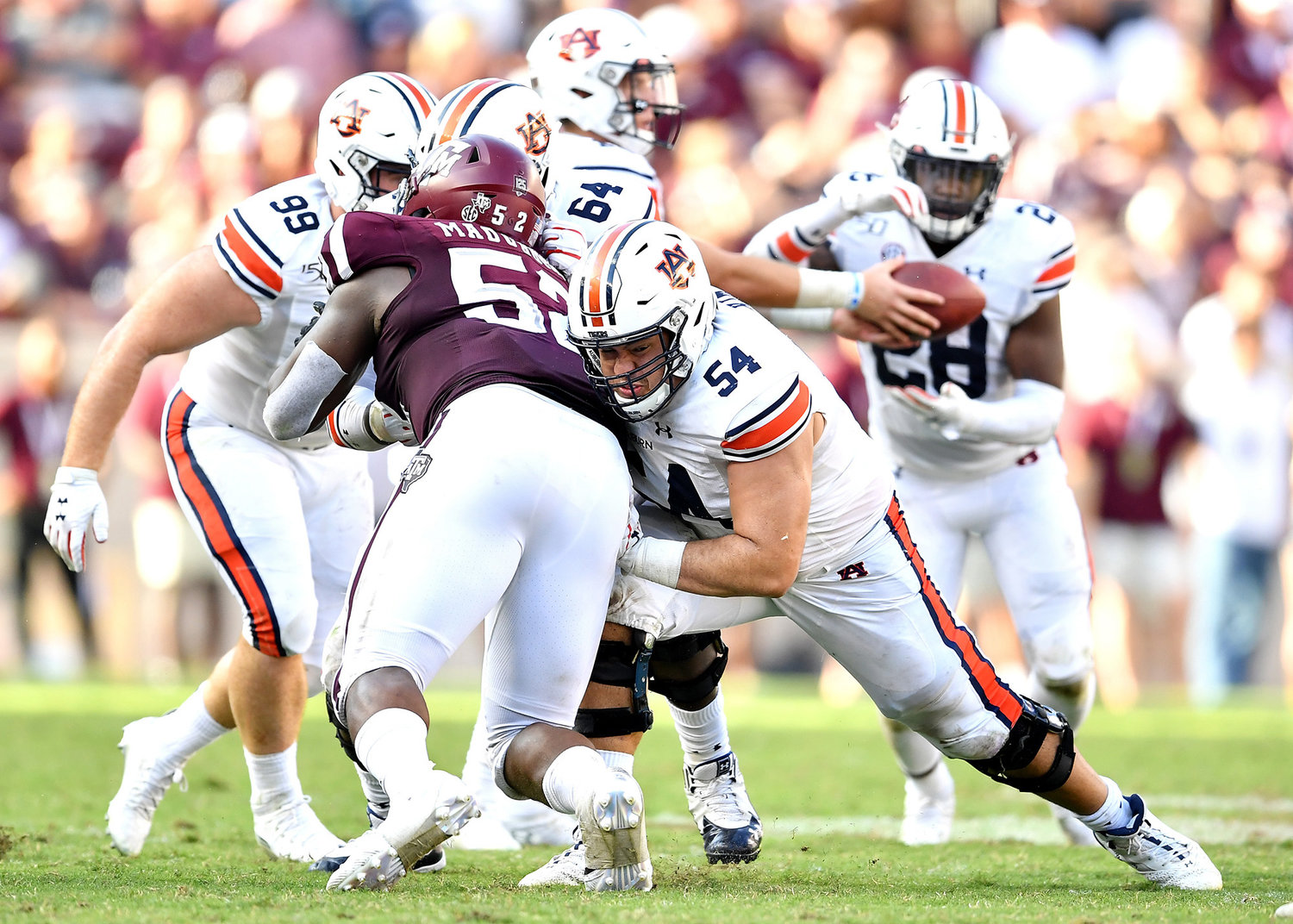 Auburn Tigers offensive lineman Kaleb Kim (54) sets a block for running back JaTarvious Whitlow (28) during the second half of an NCAA football game against the Texas A&M Aggies Saturday, Sept. 21, 2019, at Kyle Field in College Station Texas. Auburn wins 28-20.