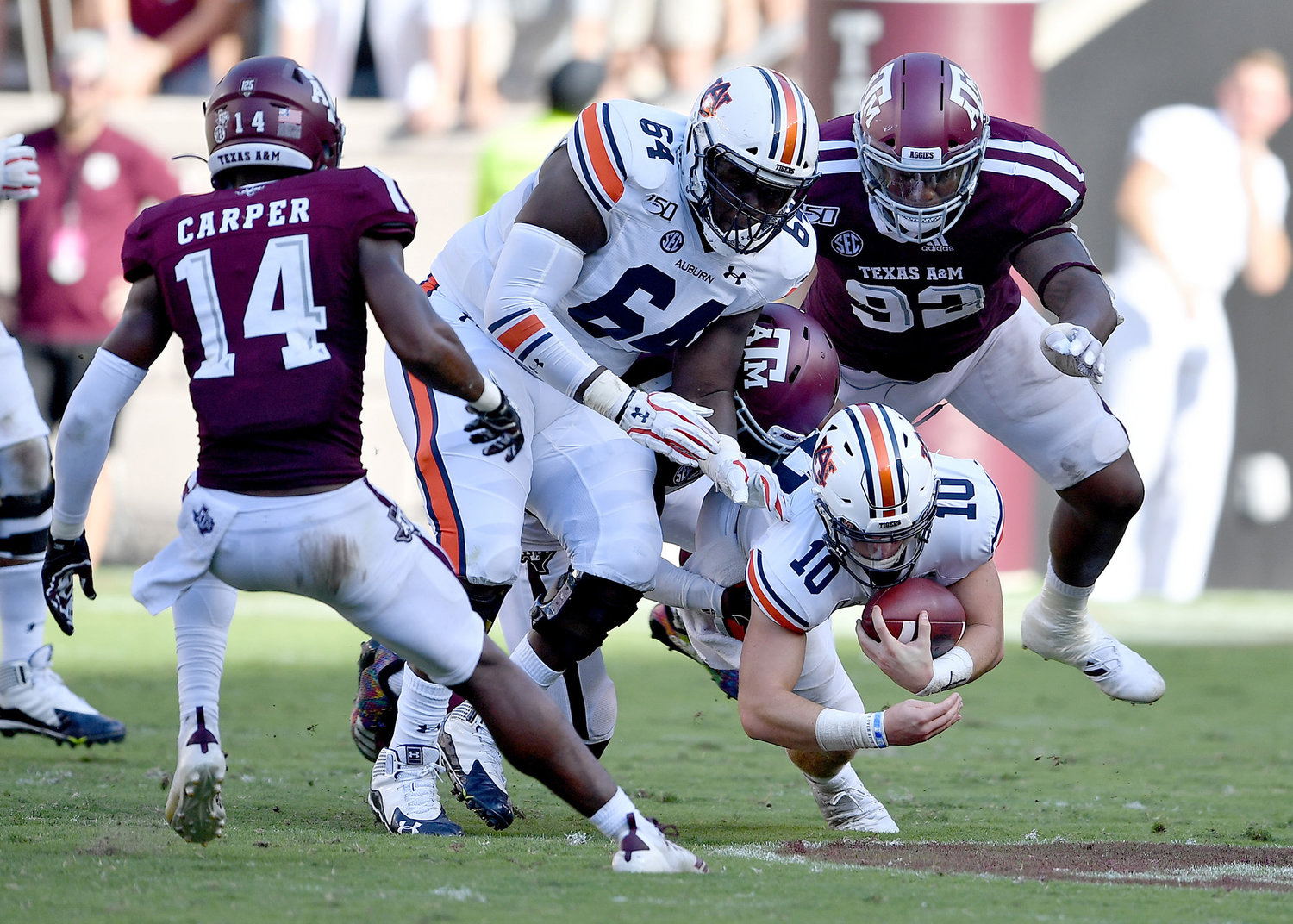 Auburn Tigers quarterback Bo Nix (10) dives for extra yards on a quarterback keeper during the second half of an NCAA football game against the Texas A&M Aggies Saturday, Sept. 21, 2019, at Kyle Field in College Station Texas. Auburn wins 28-20.