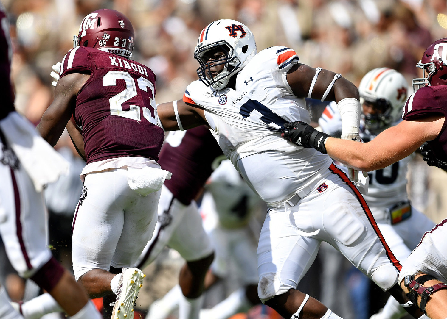 Auburn Tigers defensive end Marlon Davidson (3) reaches out to arm tackle Texas A&M Aggies running back Jacob Kibodi (23) during the first half of an NCAA football game Saturday, Sept. 21, 2019, at Kyle Field in College Station Texas. Auburn wins 28-20.