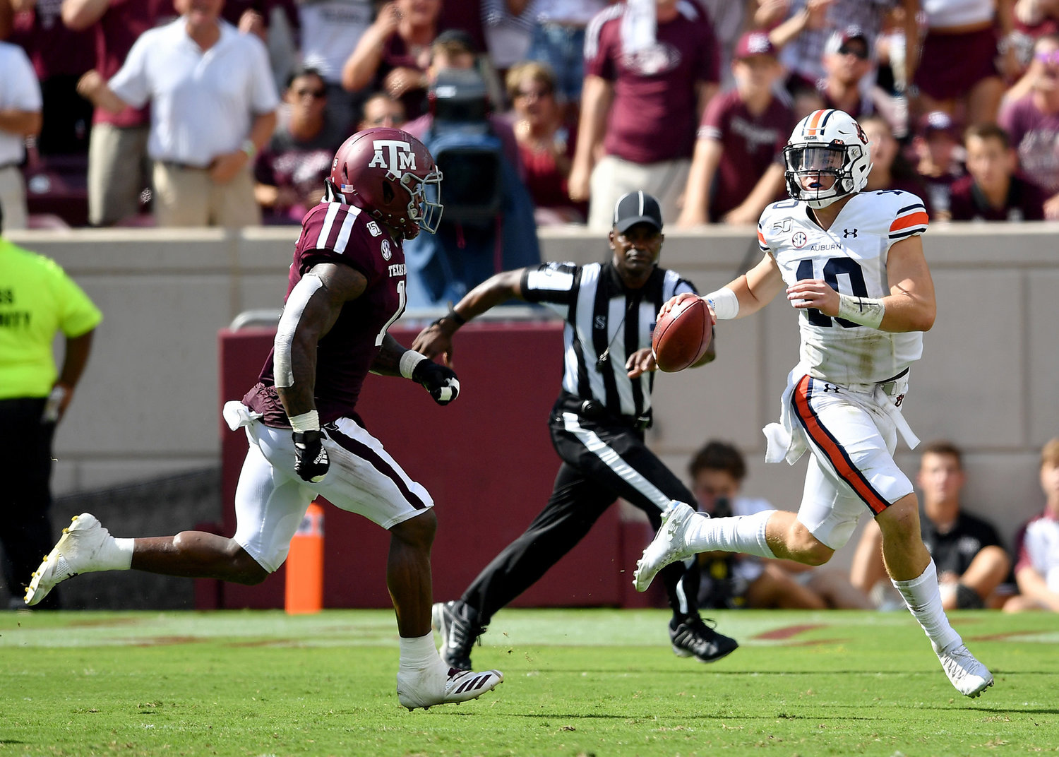 Auburn Tigers quarterback Bo Nix (10) looks for a receiver while under pressure during the first half of an NCAA football game against the Texas A&M Aggies Saturday, Sept. 21, 2019, at Kyle Field in College Station Texas. Auburn wins 28-20.