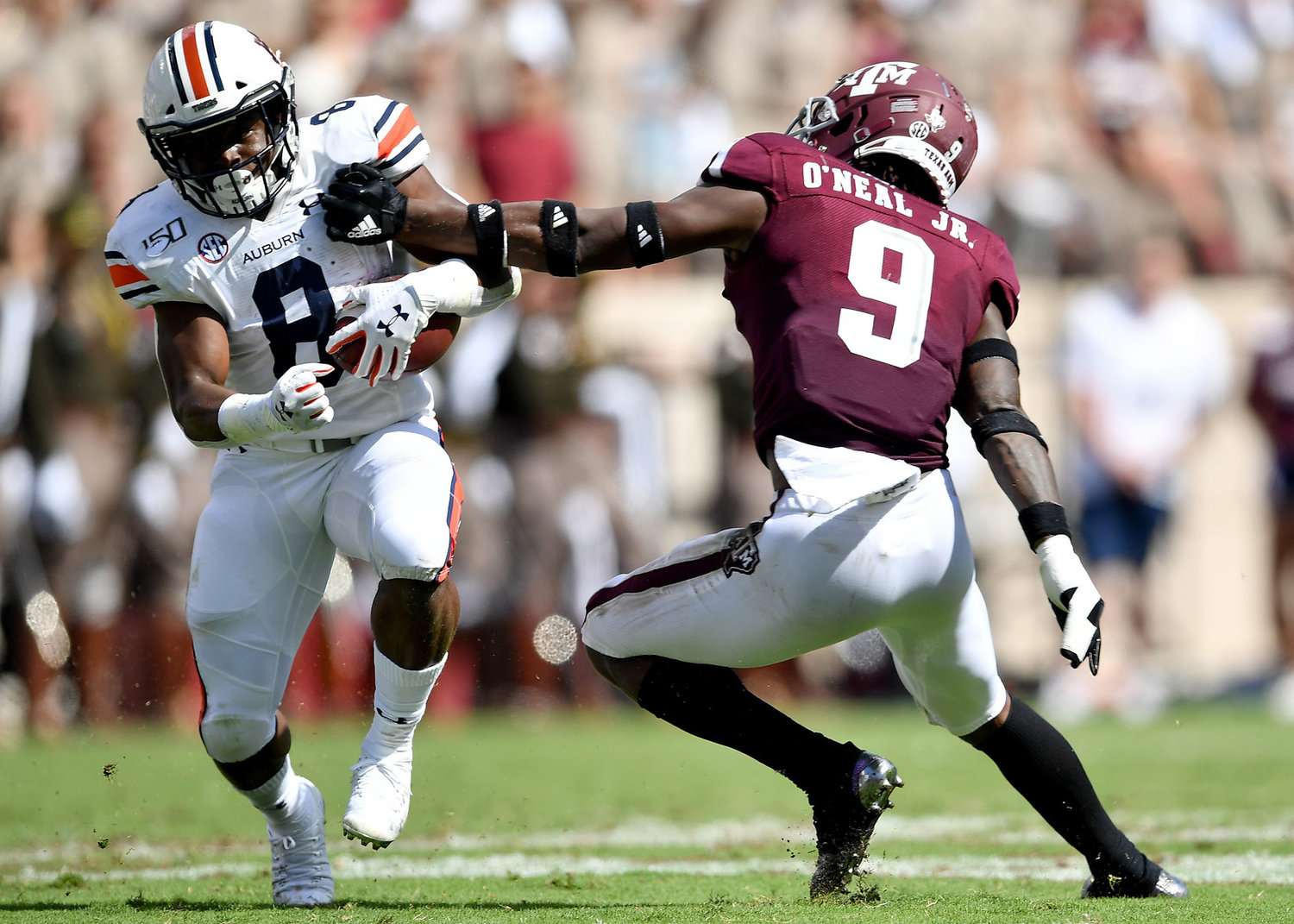 Auburn Tigers running back Shaun Shivers (8) avoids the tackle of Texas A&M Aggies defensive back Leon O'Neal Jr. (9) in the first half of an NCAA football game Saturday, Sept. 21, 2019, at Kyle Field in College Station Texas. Auburn wins 28-20.