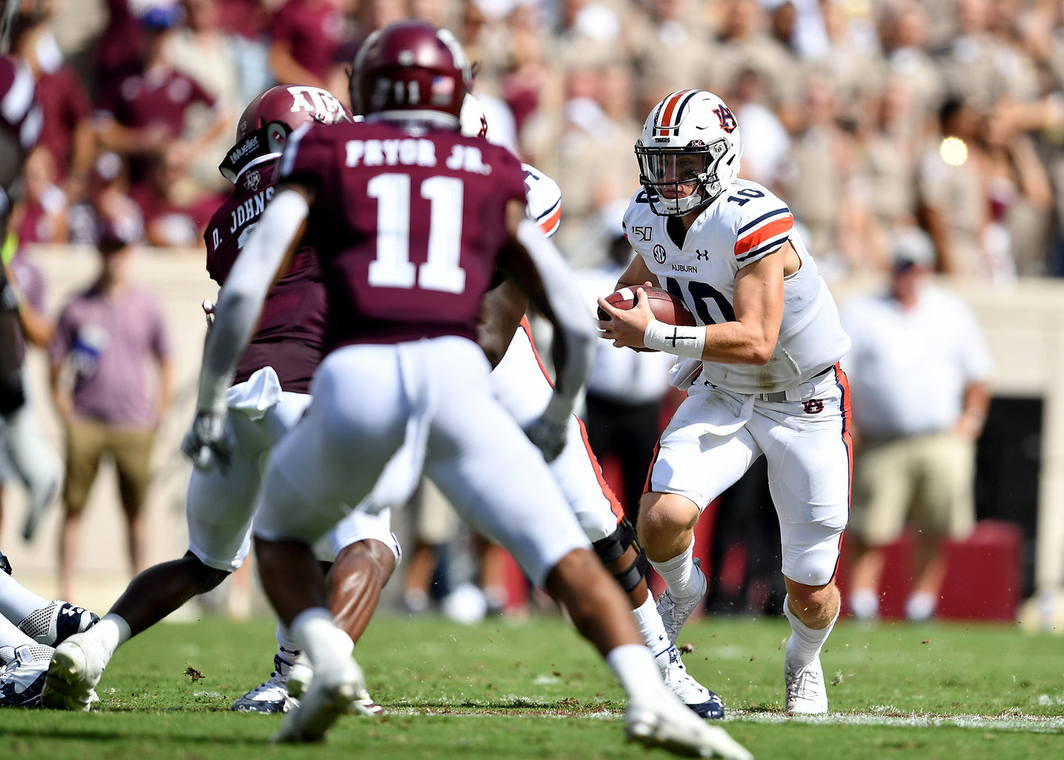 Auburn Tigers quarterback Bo Nix (10) looks for room to run with a quarterback keeper during the first half of an NCAA football game against the Texas A&M Aggies Saturday, Sept. 21, 2019, at Kyle Field in College Station Texas. Auburn wins 28-20.