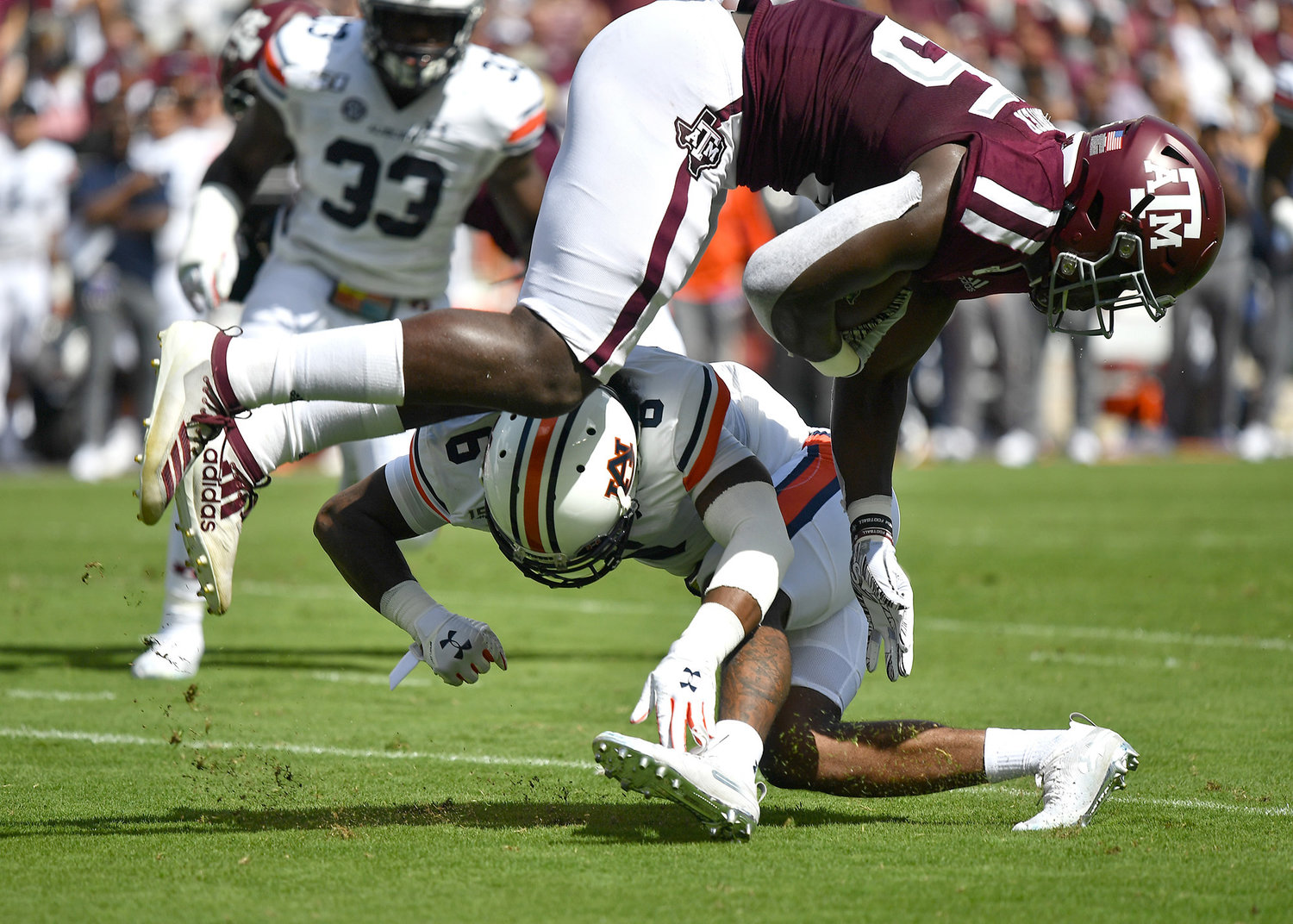 Auburn Tigers defensive back Christian Tutt (6) tackles a Texas A&M Aggies player during the first quarter of an NCAA football game Saturday, Sept. 21, 2019, at Kyle Field in College Station Texas. Auburn wins 28-20.
