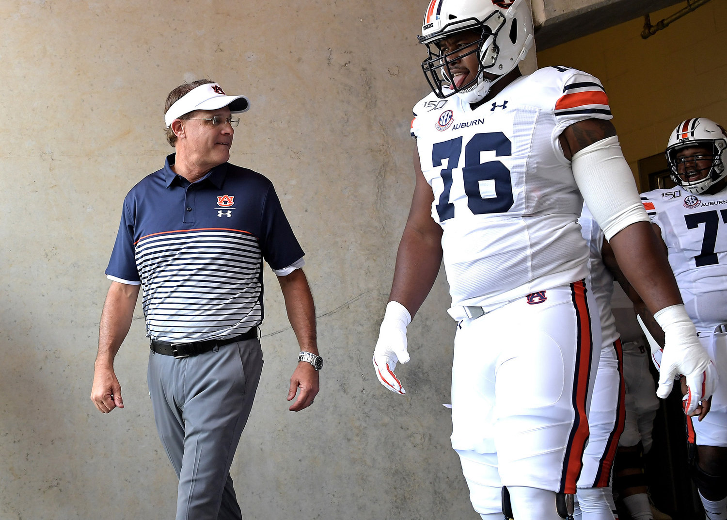 Auburn Tigers head coach Gus Malzahn leaves the locker room next to Auburn Tigers offensive lineman Prince Tega Wanogho (76) prior to the start of an NCAA football game between the Texas A&M Aggies and the Tigers Saturday, Sept. 21, 2019, at Kyle Field in College Station Texas. Auburn wins 28-20.