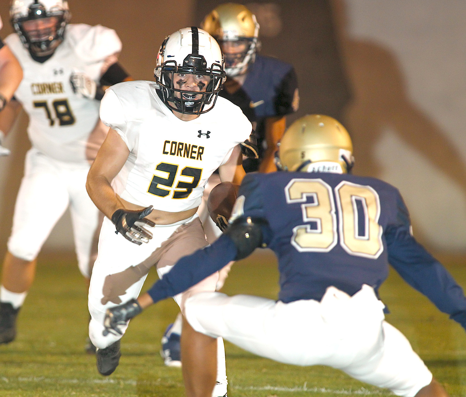 Corner's Thomas Reed looks to confront Dora's Kaleb Towns during their game Friday night.
