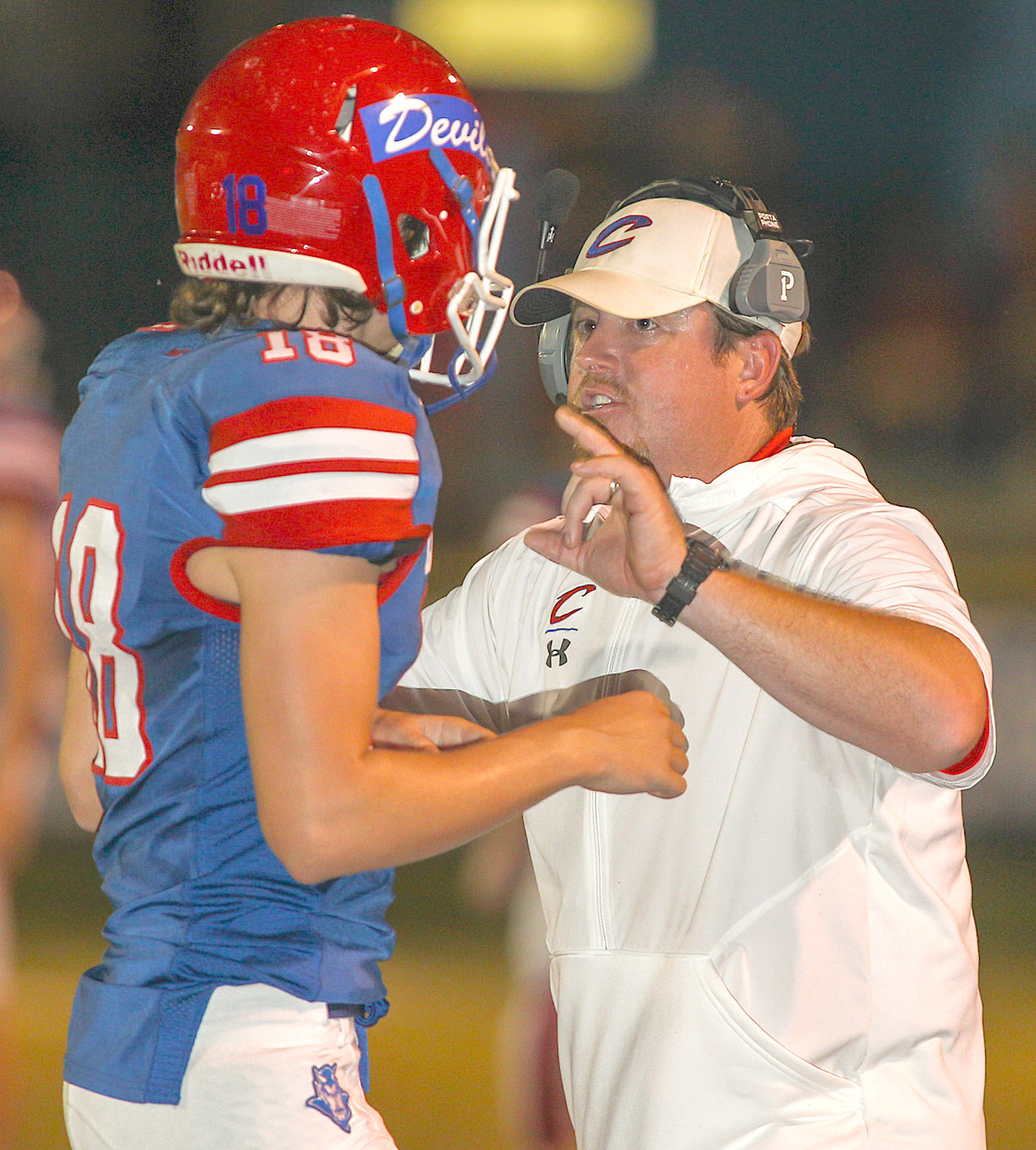 Cordova Head Coach Justin Jones talks with Mason Farley during Friday night's game against Good Hope.
