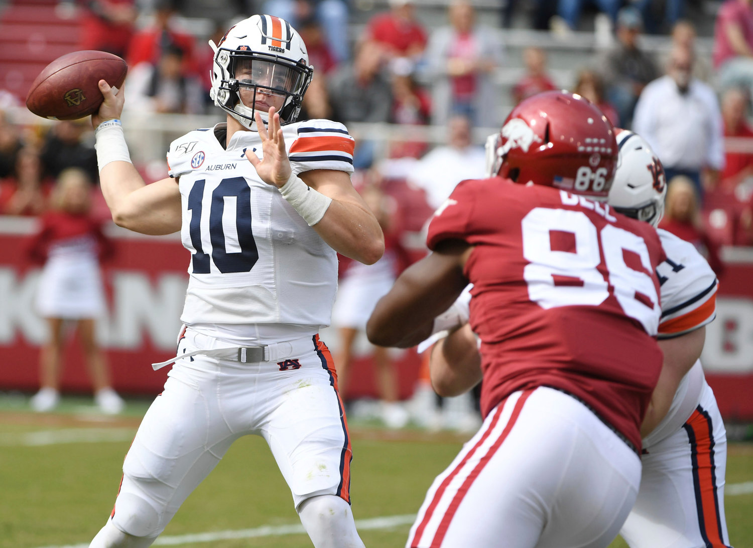 Auburn quarterback Bo Nix throws a pass against Arkansas during Saturday's game in Fayetteville, Ark. Nix threw three touchdown passes and rushed for another score in the Tigers' 51-10 win.