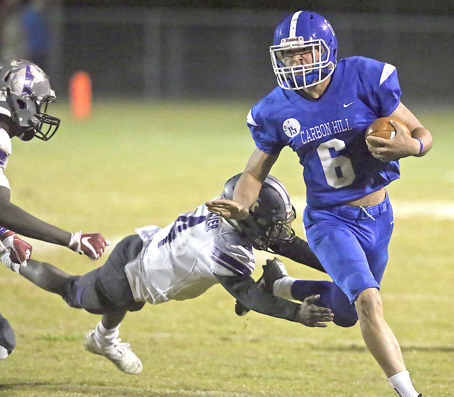 Carbon Hill's Devon Daniel (6) looks to evade a Holt defender on Thursday.