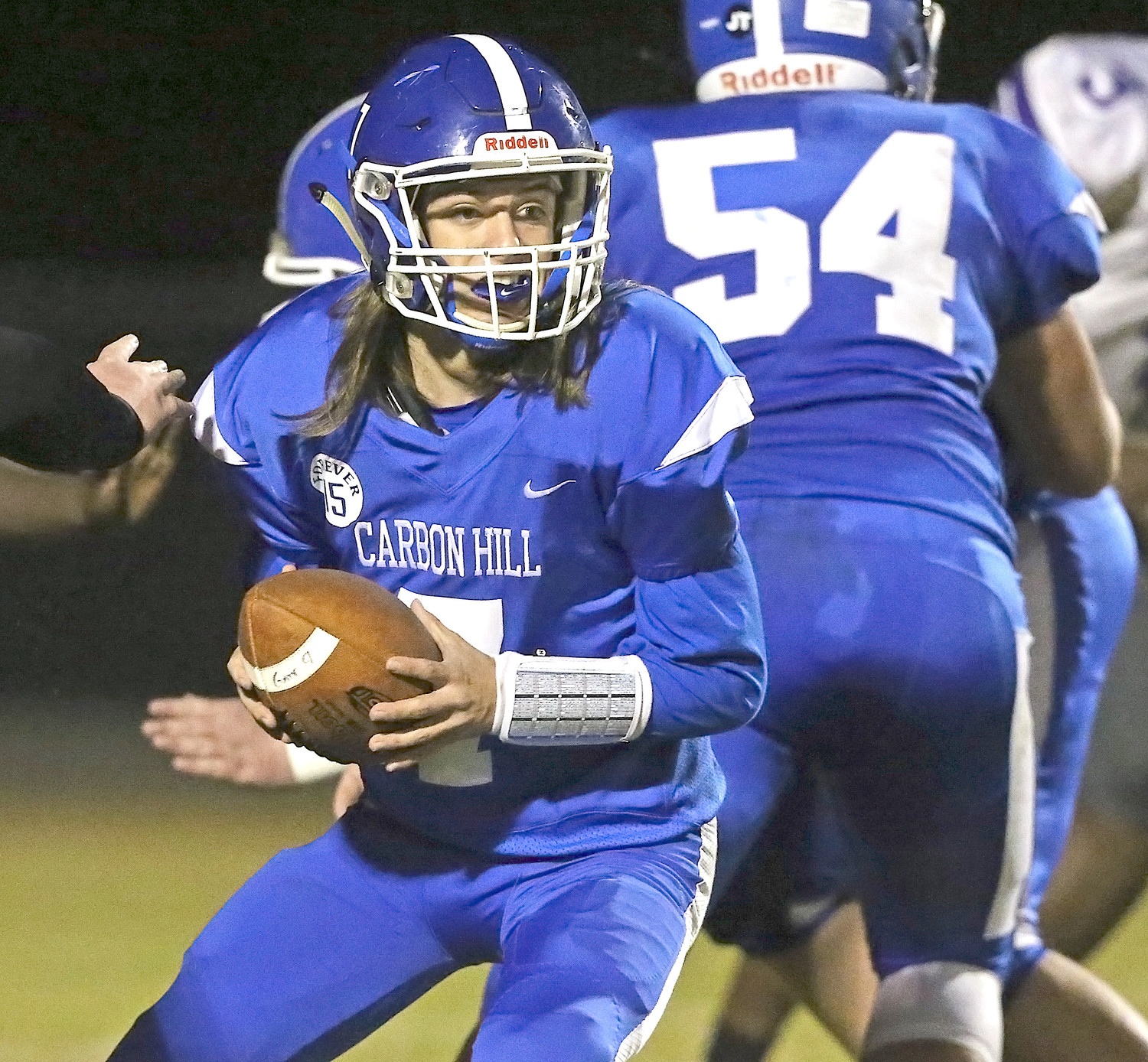 Carbon Hill quarterback Clay Tittle looks to make a handoff during Thursday's game against Holt.