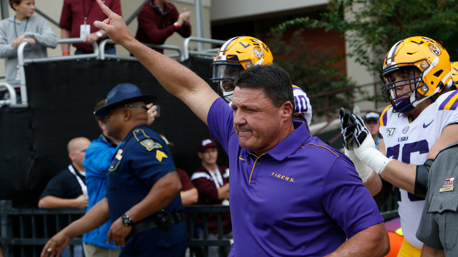 LSU head coach Ed Orgeron gestures as he leads his team on the field prior to their NCAA college football game against Mississippi State in Starkville, Miss., Saturday, Oct. 19, 2019. LSU won 36-13. (AP Photo/Rogelio V. Solis)
