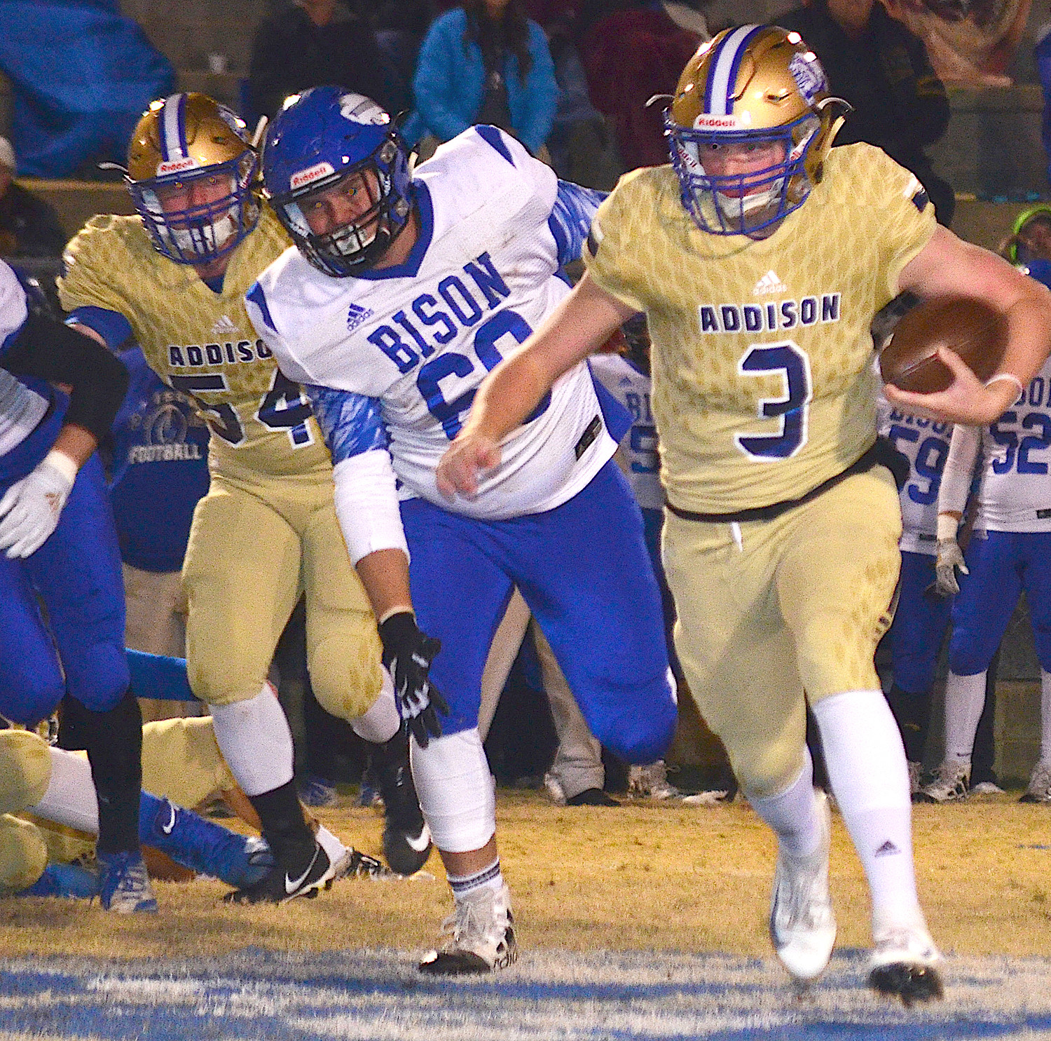 Addison's Christian Roberts (3) looks for running room against North Sand Mountain during their first-round game Friday night. The Bison upset the Bulldogs 20-13.
