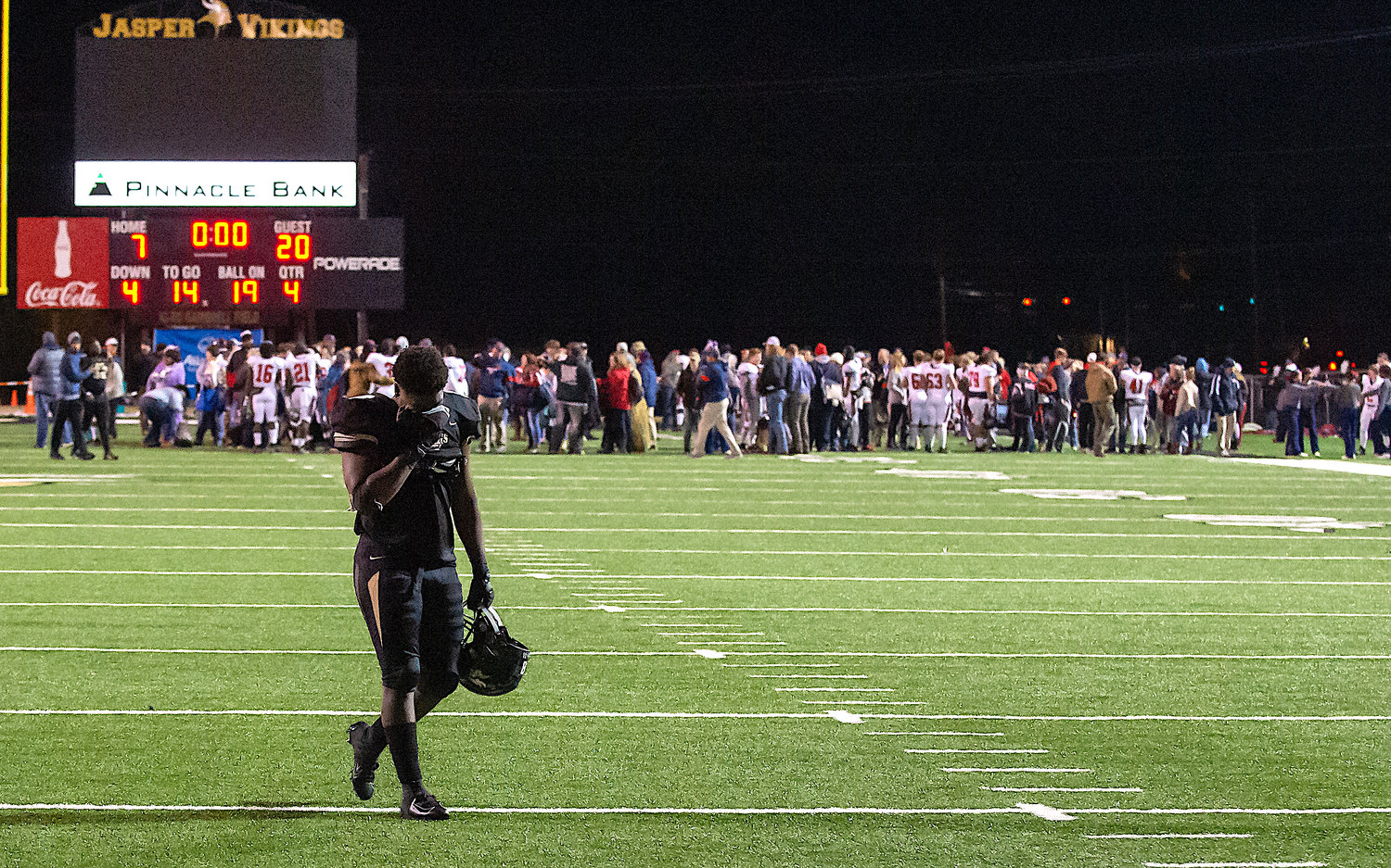 A Jasper player walks off the field following Friday's season-ending loss to Central-Clay County.