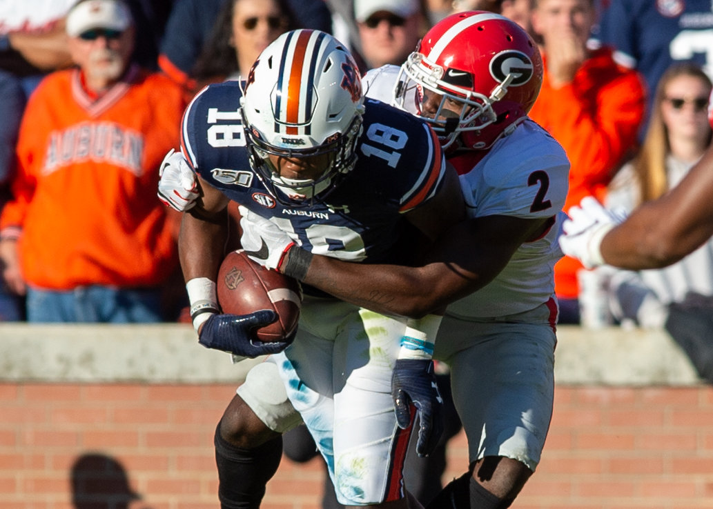 Auburn Tigers wide receiver Seth Williams (18) is tackled by Georgia Bulldogs defensive back Richard LeCounte (2) during the first half of Saturday's game, at Jordan-Hare Stadium in Auburn,, AL. Daily Mountain Eagle -  Jeff Johnsey