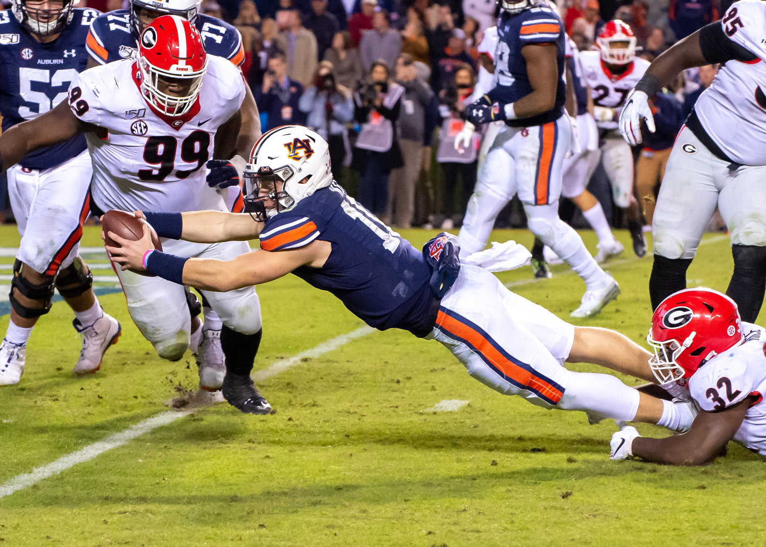 Auburn Tigers quarterback Bo Nix (10)dives for a score during the second half of Saturday's game, at Jordan-Hare Stadium in Auburn,, AL. Daily Mountain Eagle -  Jeff Johnsey