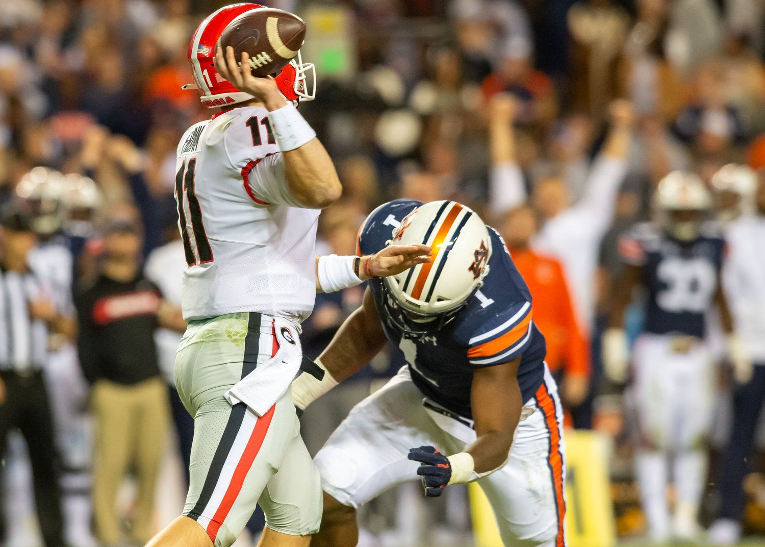 Georgia Bulldogs quarterback Jake Fromm (11) is pressured by Auburn Tigers defensive end Big Kat Bryant (1) during the second half of Saturday's game, at Jordan-Hare Stadium in Auburn,, AL. Daily Mountain Eagle -  Jeff Johnsey