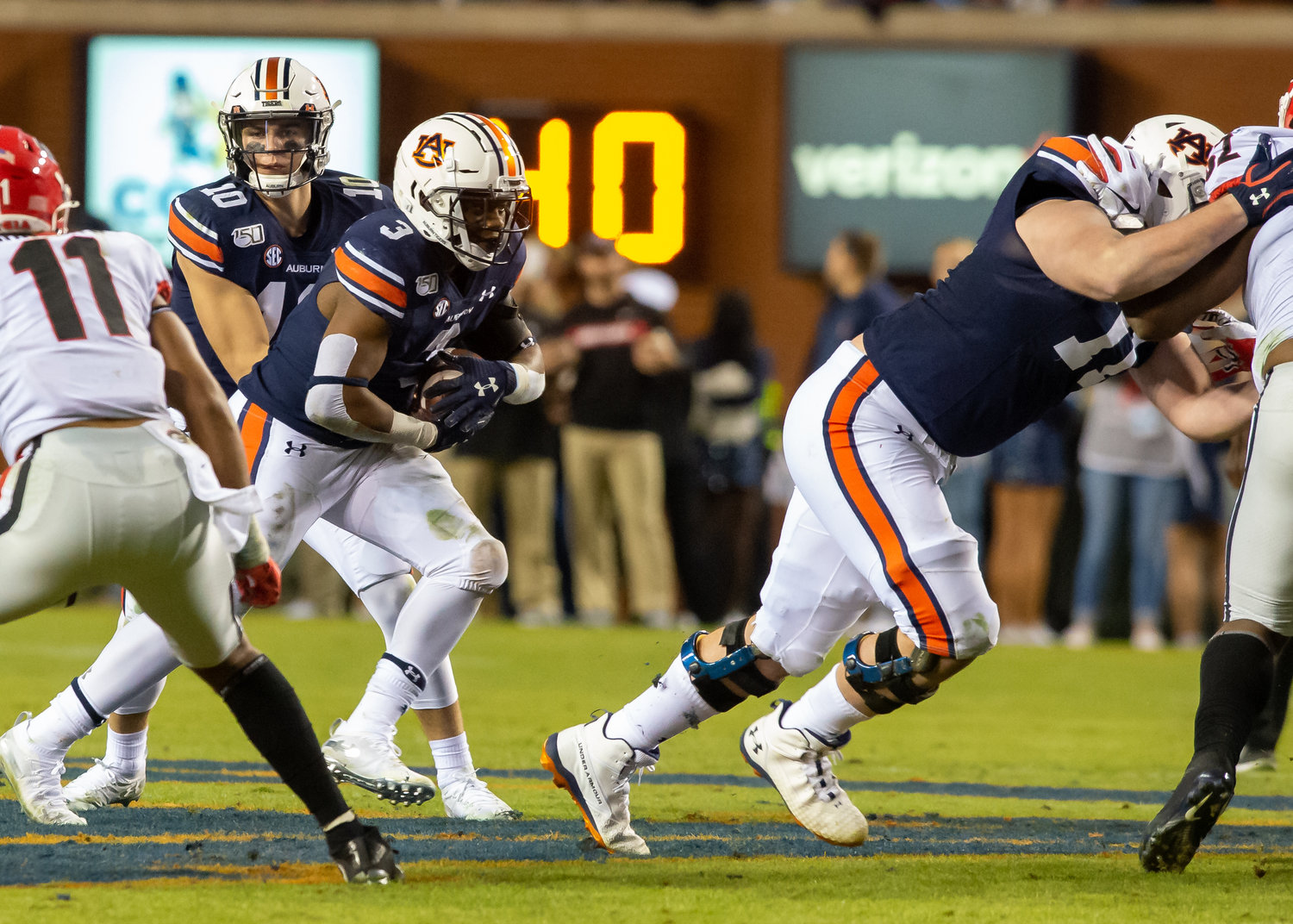 Auburn Tigers running back D.J. Williams (3) runs behind the blocking of Auburn Tigers offensive lineman Jack Driscoll (71) during the second half of Saturday's game, at Jordan-Hare Stadium in Auburn,, AL. Daily Mountain Eagle -  Jeff Johnsey