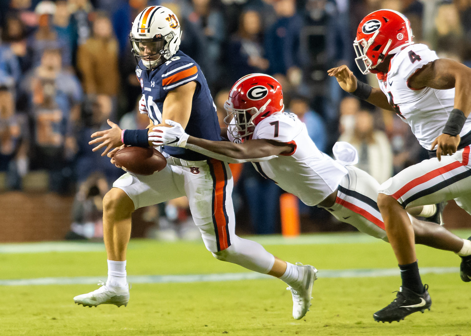Georgia Bulldogs defensive back Tyrique Stevenson (7) dives for Auburn Tigers quarterback Bo Nix (10) during the second half of Saturday's game, at Jordan-Hare Stadium in Auburn,, AL. Daily Mountain Eagle -  Jeff Johnsey