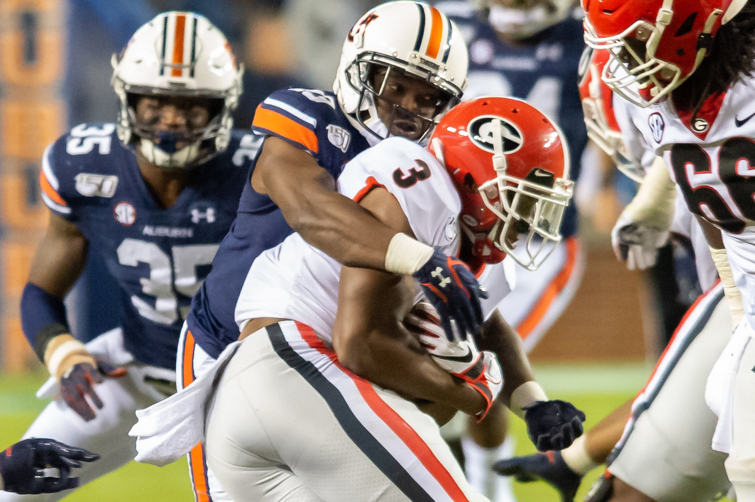 Auburn Tigers defensive back Javaris Davis (13) wraps up Georgia Bulldogs running back Zamir White (3) during the second half of Saturday's game, at Jordan-Hare Stadium in Auburn,, AL. Daily Mountain Eagle -  Jeff Johnsey