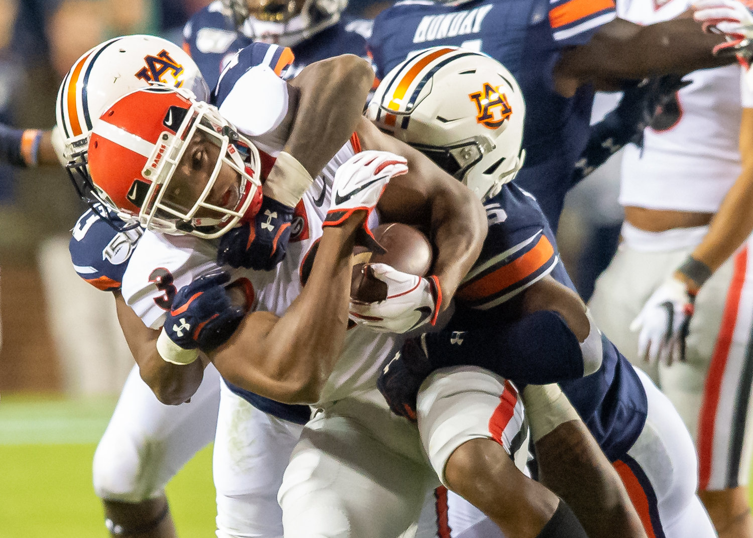 Georgia Bulldogs running back Zamir White (3) is brought down by Auburn Tigers linebacker Zakoby McClain (35) during the second half of Saturday's game, at Jordan-Hare Stadium in Auburn,, AL. Daily Mountain Eagle -  Jeff Johnsey