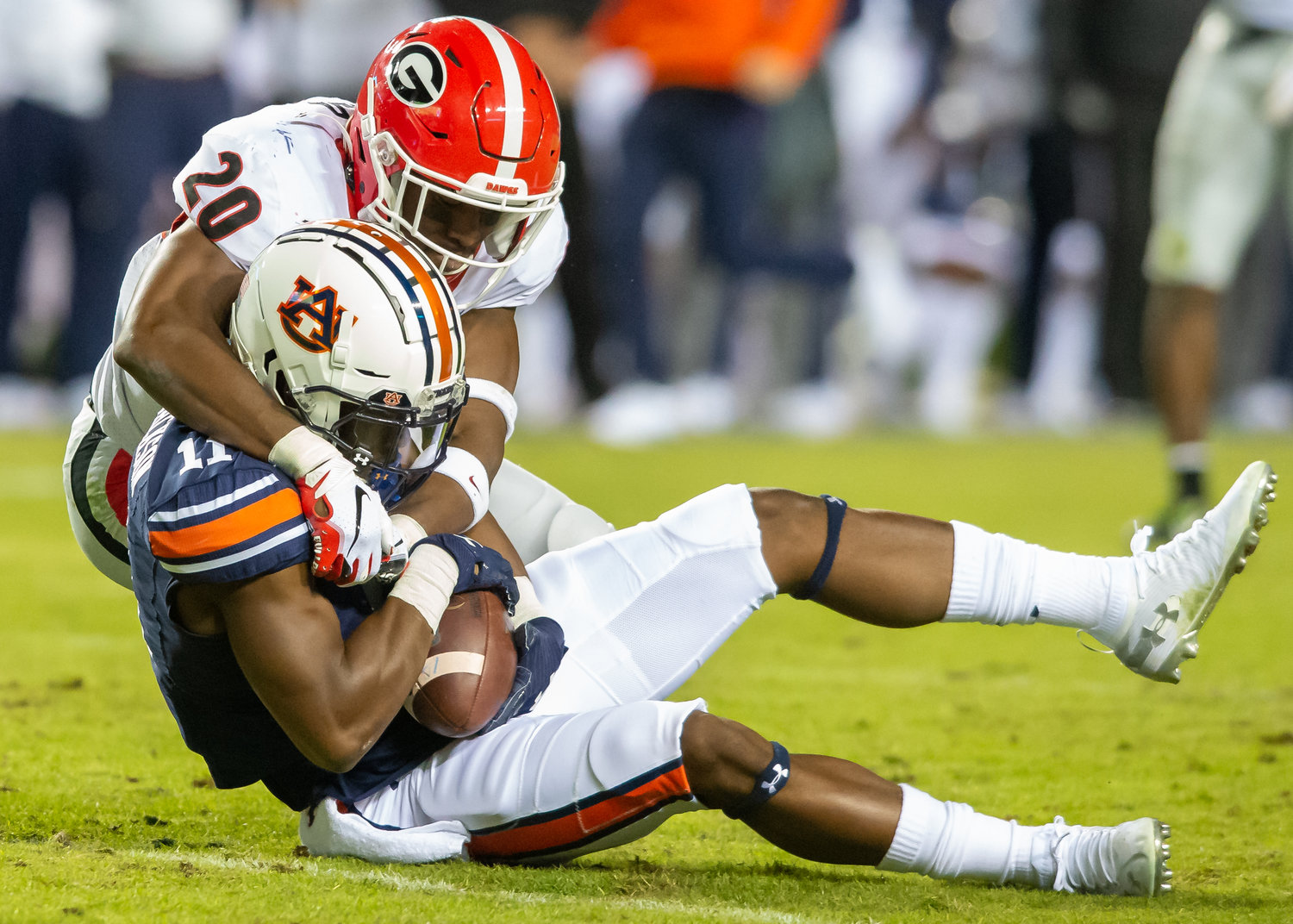 Georgia Bulldogs defensive back J.R. Reed (20) tackles Auburn Tigers wide receiver Shedrick Jackson (11) during the second half of Saturday's game, at Jordan-Hare Stadium in Auburn,, AL. Daily Mountain Eagle -  Jeff Johnsey