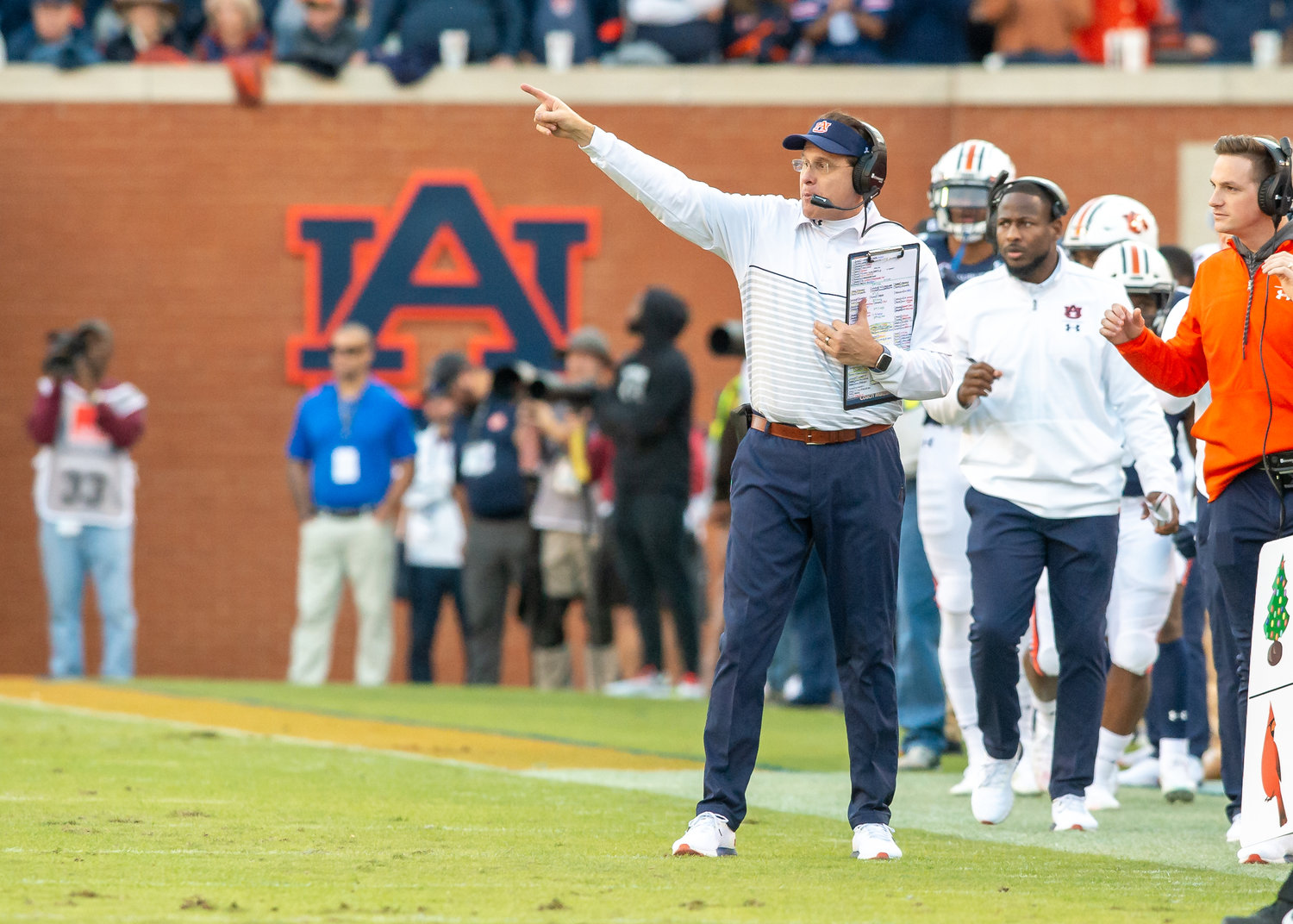 Auburn Tigers head coach Gus Malzahn signals  during the first half of Saturday's game, at Jordan-Hare Stadium in Auburn,, AL. Daily Mountain Eagle -  Jeff Johnsey