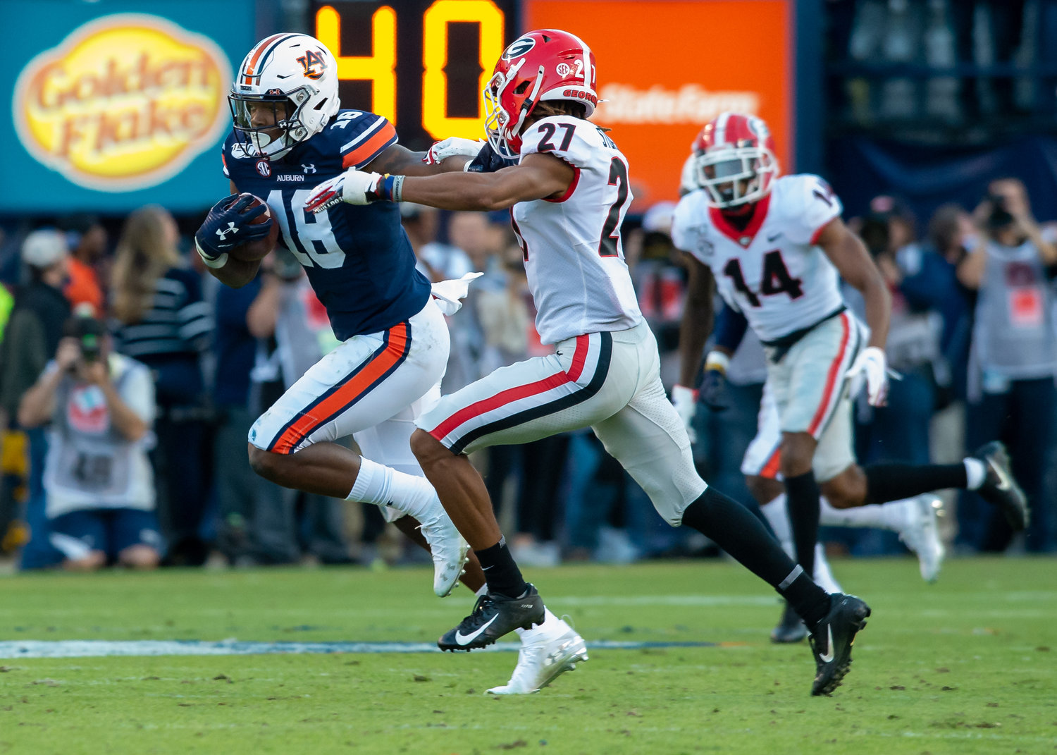 Auburn Tigers wide receiver Seth Williams (18)runs past Georgia Bulldogs defensive back Eric Stokes (27) during the first half of Saturday's game, at Jordan-Hare Stadium in Auburn,, AL. Daily Mountain Eagle -  Jeff Johnsey