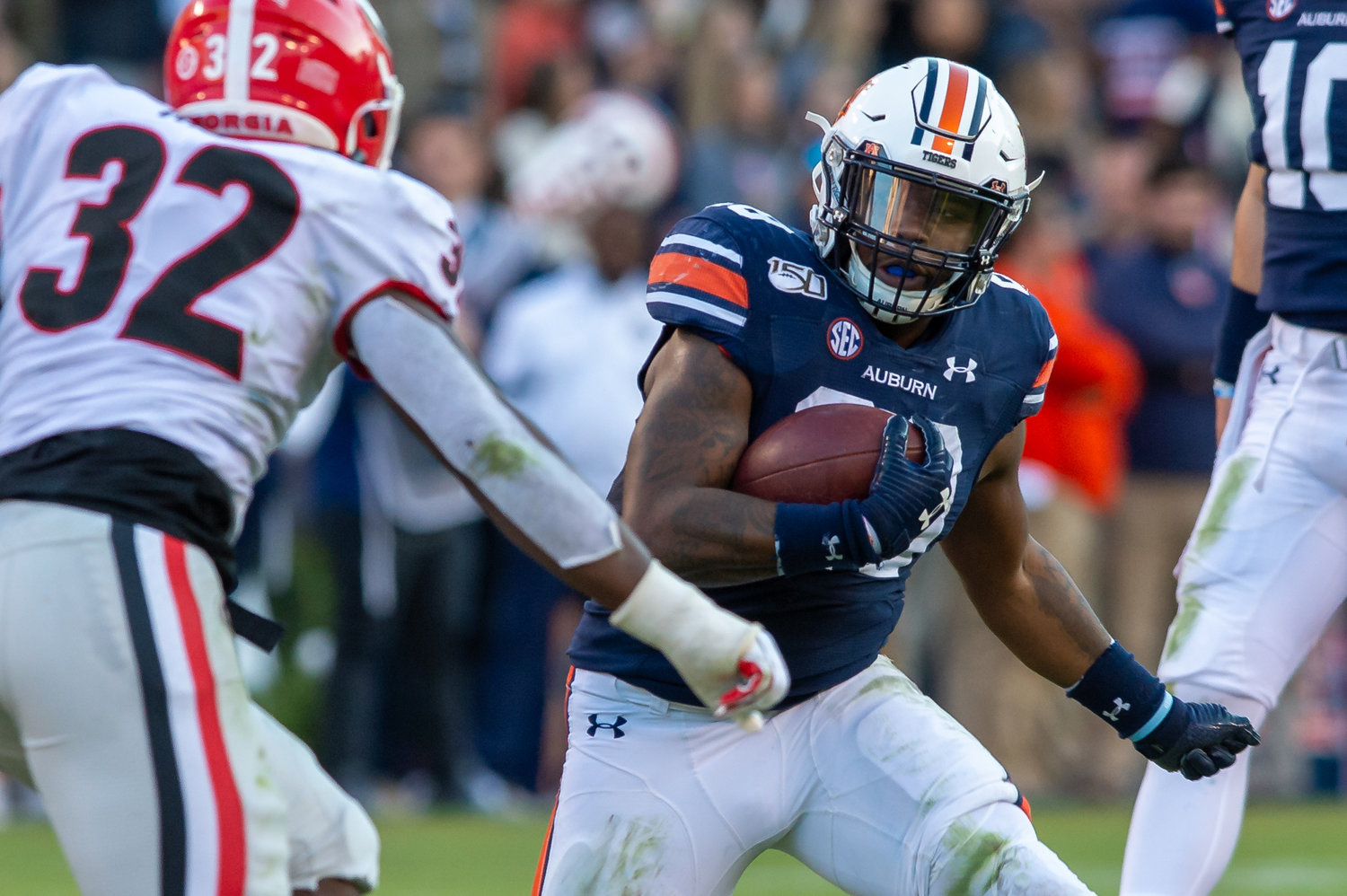 Auburn Tigers running back JaTarvious Whitlow (28) looks for running room during the first half of Saturday's game, at Jordan-Hare Stadium in Auburn,, AL. Daily Mountain Eagle -  Jeff Johnsey