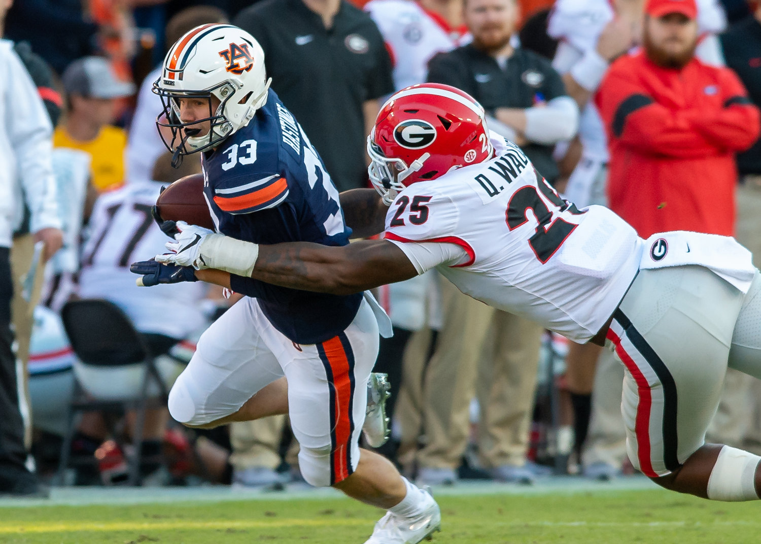 Auburn Tigers wide receiver Will Hastings (33) is tackled by Georgia Bulldogs linebacker Quay Walker (25) during the first half of Saturday's game, at Jordan-Hare Stadium in Auburn,, AL. Daily Mountain Eagle -  Jeff Johnsey