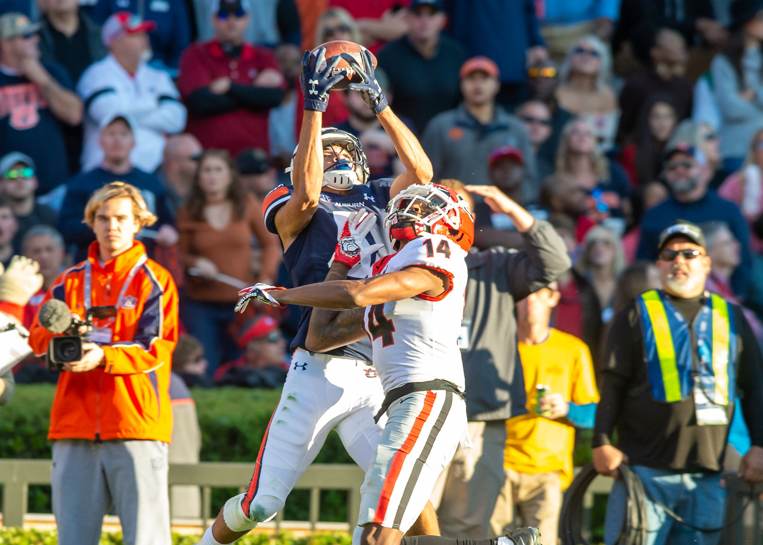 Auburn Tigers wide receiver Anthony Schwartz (5) tries to make a catch over Georgia Bulldogs defensive back DJ Daniel (14) during the first half of Saturday's game, at Jordan-Hare Stadium in Auburn,, AL. Daily Mountain Eagle -  Jeff Johnsey