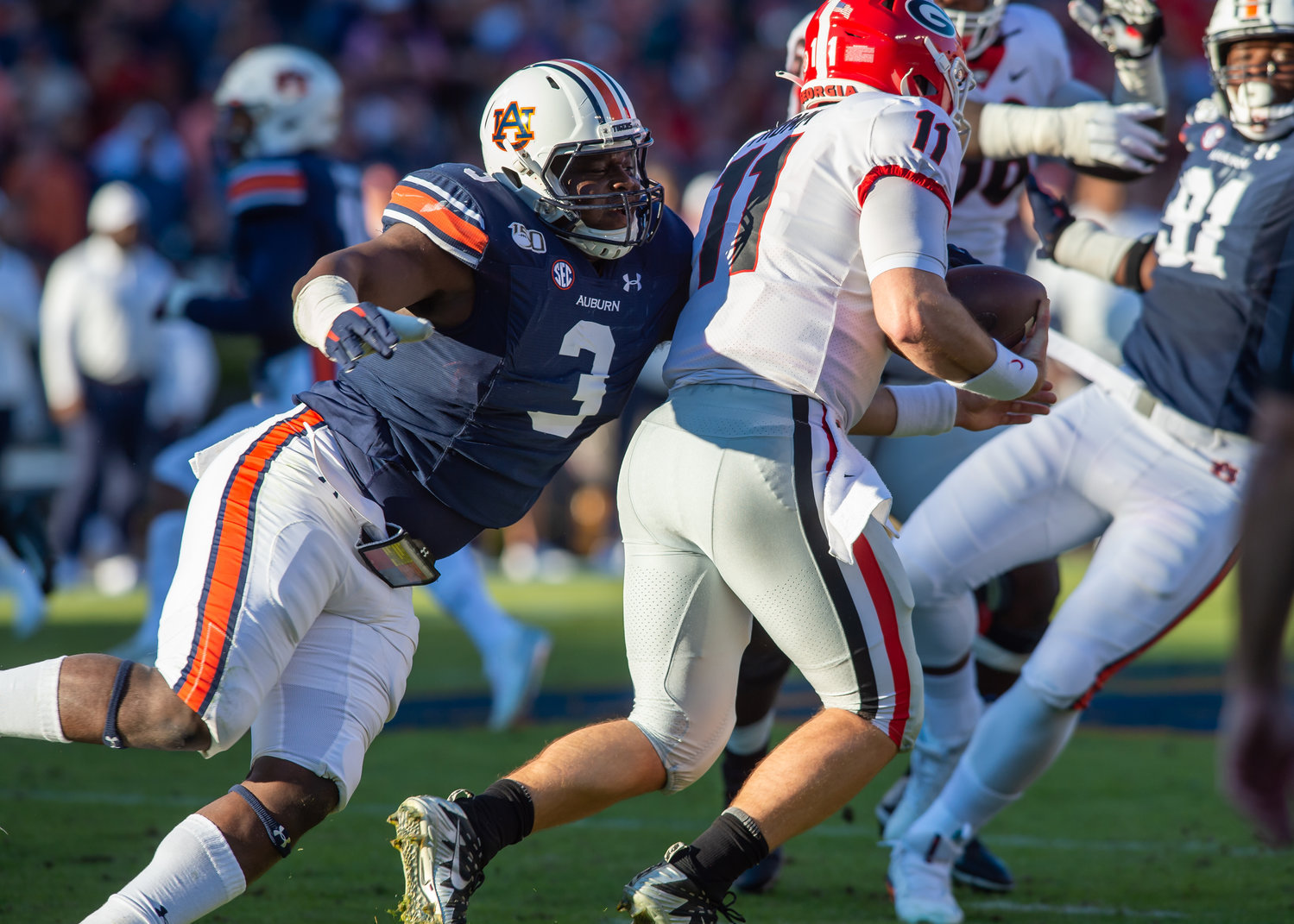 Auburn Tigers defensive end Marlon Davidson (3) sacks Georgia Bulldogs quarterback Jake Fromm (11) during the first half of Saturday's game, at Jordan-Hare Stadium in Auburn,, AL. Daily Mountain Eagle -  Jeff Johnsey