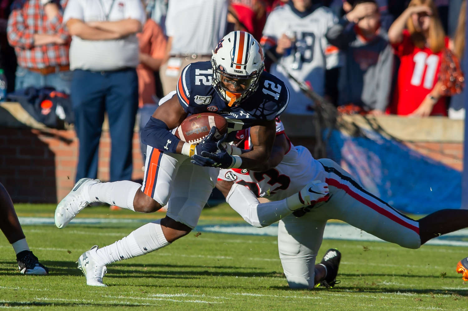 Auburn Tigers wide receiver Eli Stove (12) is brought down by Georgia Bulldogs defensive back Tyson Campbell (3) during the first half of Saturday's game, at Jordan-Hare Stadium in Auburn,, AL. Daily Mountain Eagle -  Jeff Johnsey