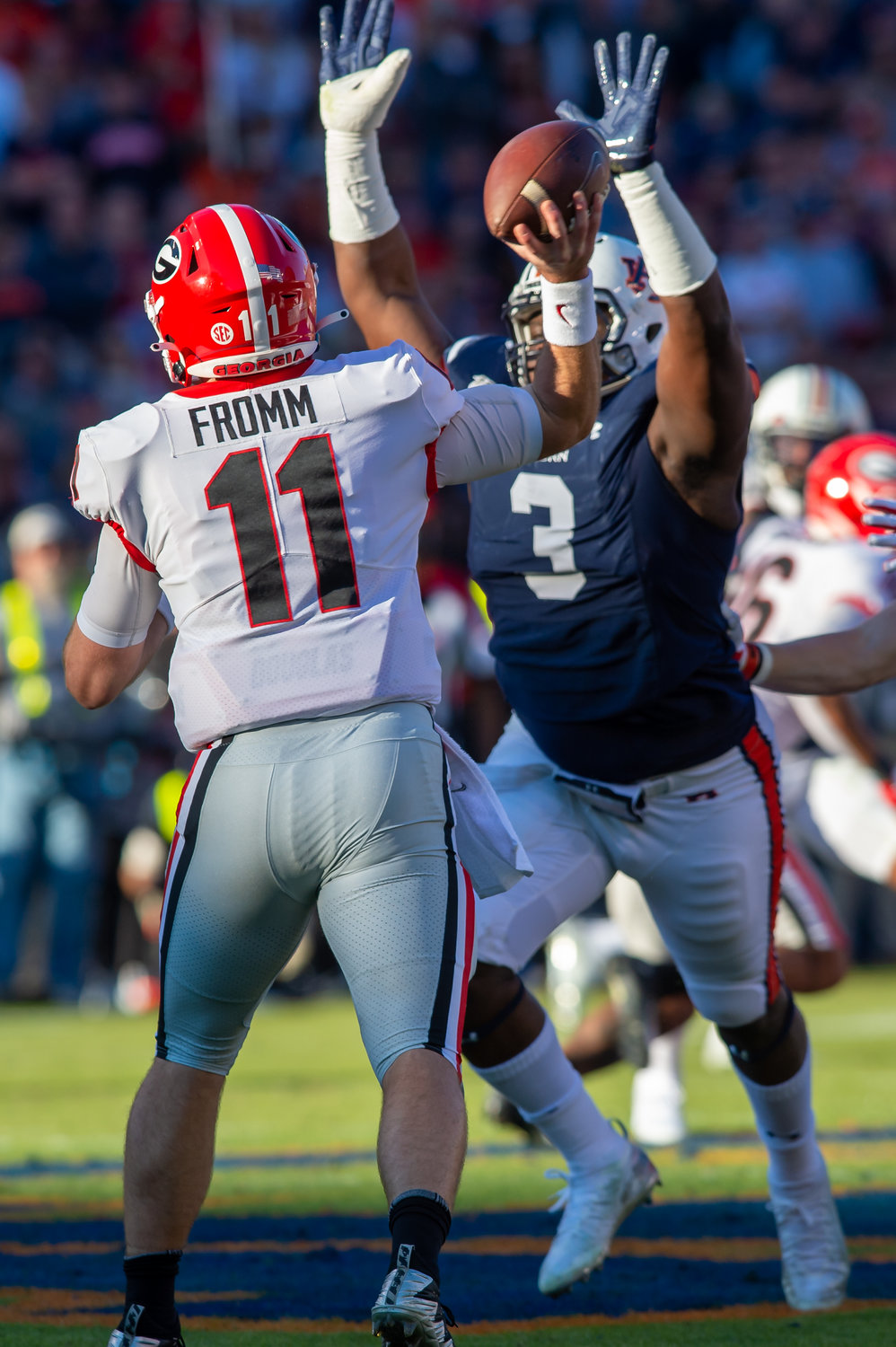 Georgia Bulldogs quarterback Jake Fromm (11) is pressured by Auburn Tigers defensive end Marlon Davidson (3) during the first half of Saturday's game, at Jordan-Hare Stadium in Auburn,, AL. Daily Mountain Eagle -  Jeff Johnsey