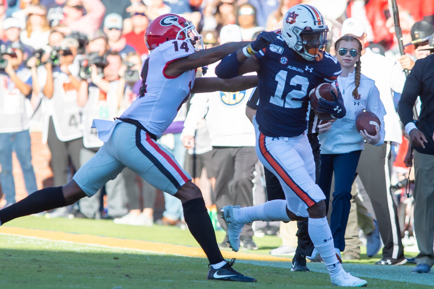 Georgia Bulldogs defensive back DJ Daniel (14) forces Auburn Tigers wide receiver Eli Stove (12) out of bounds during the first half of Saturday's game, at Jordan-Hare Stadium in Auburn,, AL. Daily Mountain Eagle -  Jeff Johnsey