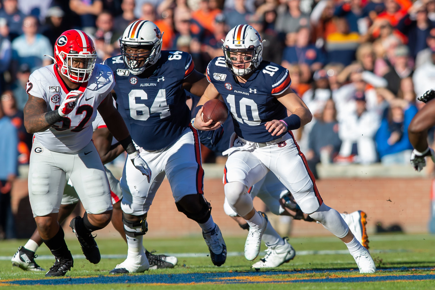 Auburn Tigers quarterback Bo Nix (10) runs during the first half of Saturday's game, at Jordan-Hare Stadium in Auburn,, AL. Daily Mountain Eagle -  Jeff Johnsey