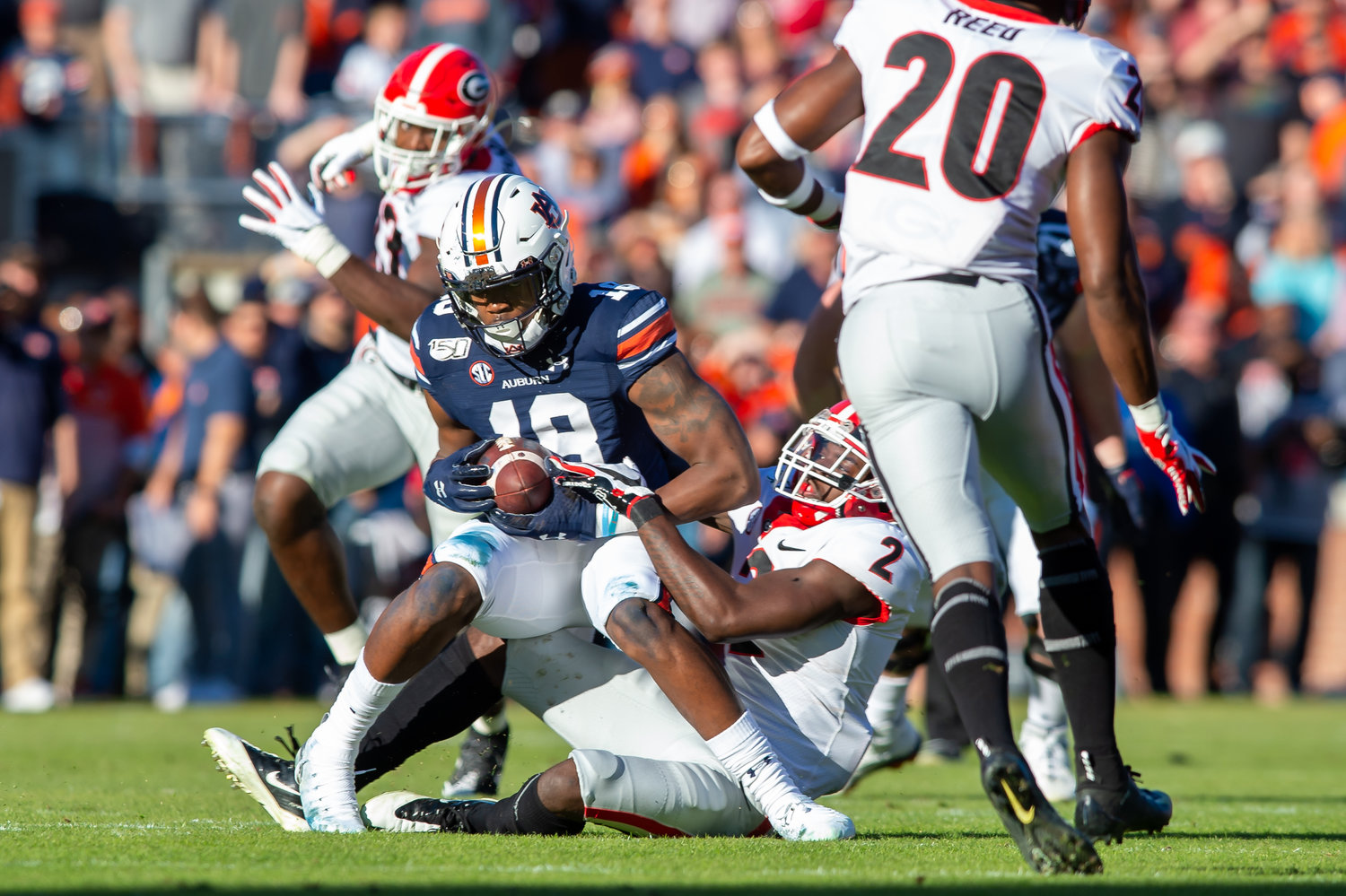 Auburn Tigers wide receiver Seth Williams (18) makes a catch in front of Georgia Bulldogs defensive back Richard LeCounte (2) during the first half of Saturday's game, at Jordan-Hare Stadium in Auburn,, AL. Daily Mountain Eagle -  Jeff Johnsey