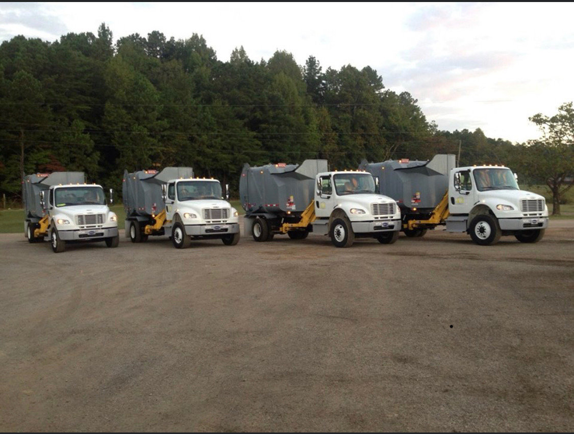 These are the four Walker County garbage trucks that were purchased several years ago to improve county service. The Walker County Commission is purchasing one truck that can replace two of the trucks, one of which may become a spare.