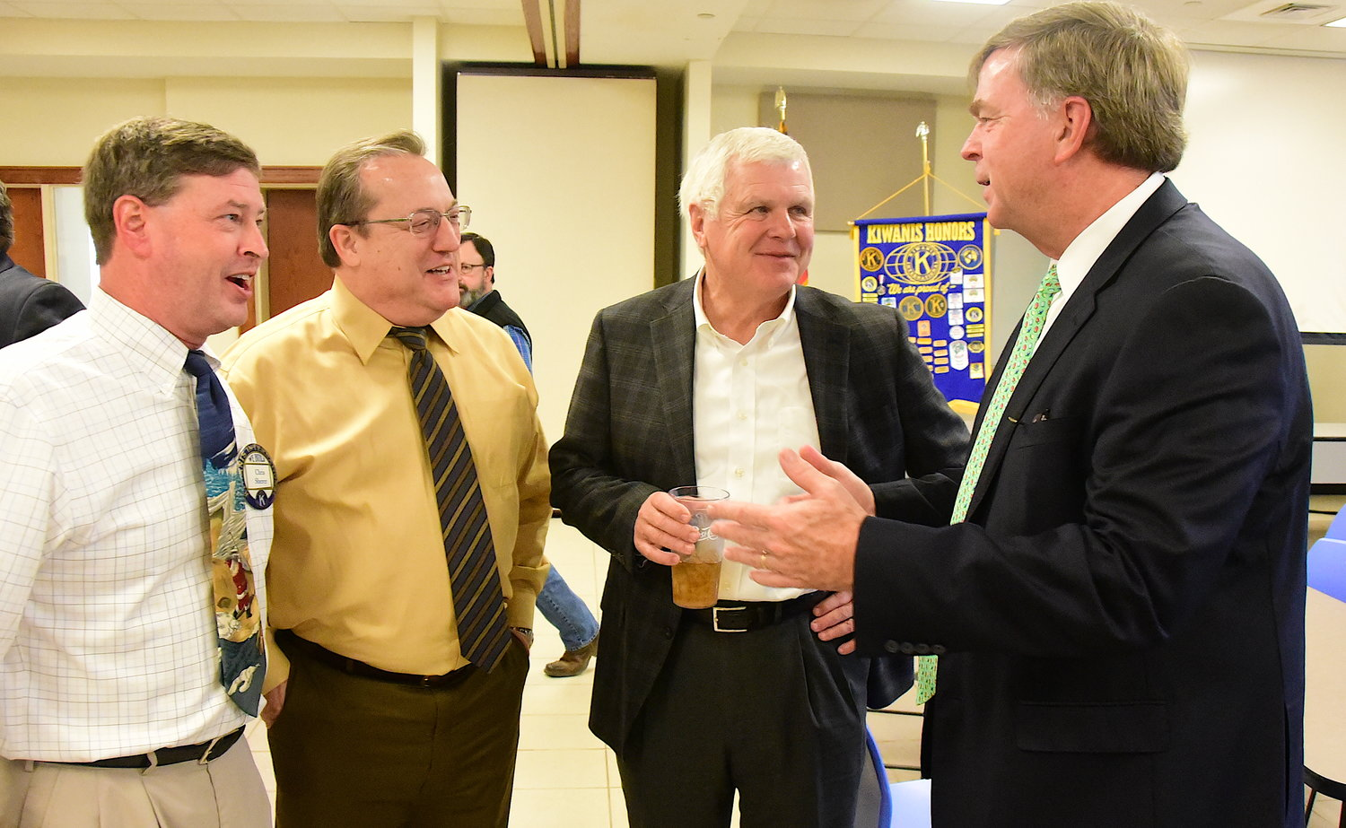 Huntsville Mayor Tommy Battle, at right, talks with Judge Chris Sherer, attorney Sam Bentley and Jasper Mayor David O'Mary following Monday's Kiwanis Club of Jasper meeting.
