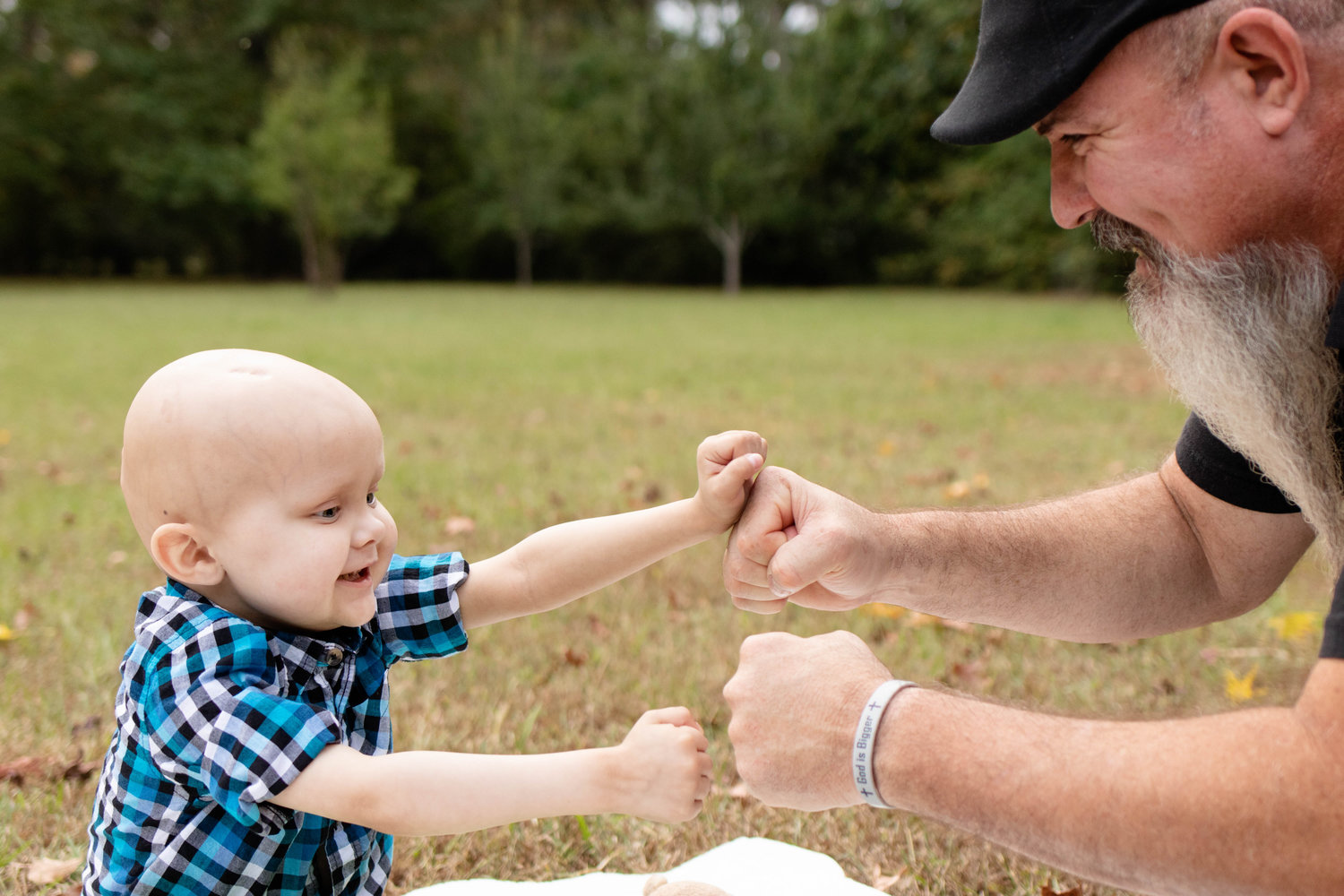Wyatt Spann and his father, Greg Spann, are seen in a photo shoot by Brittany Hackleman in September.