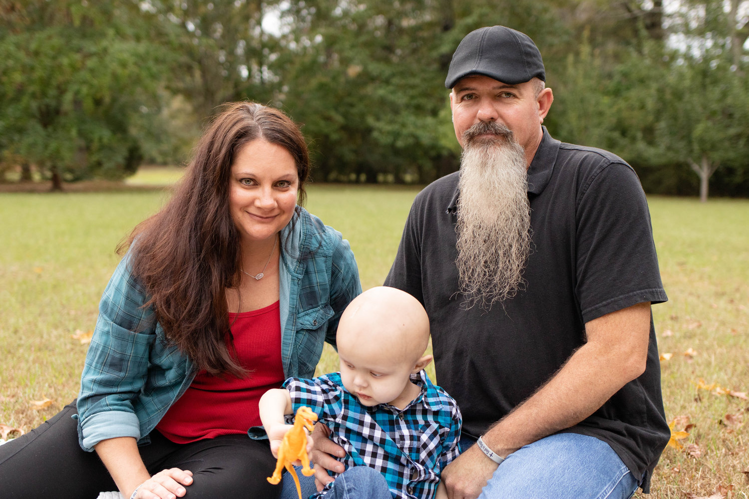 Wyatt Spann and his parents, Greg and Christy Spann, are seen in a photo shoot by Brittany Hackleman in September.