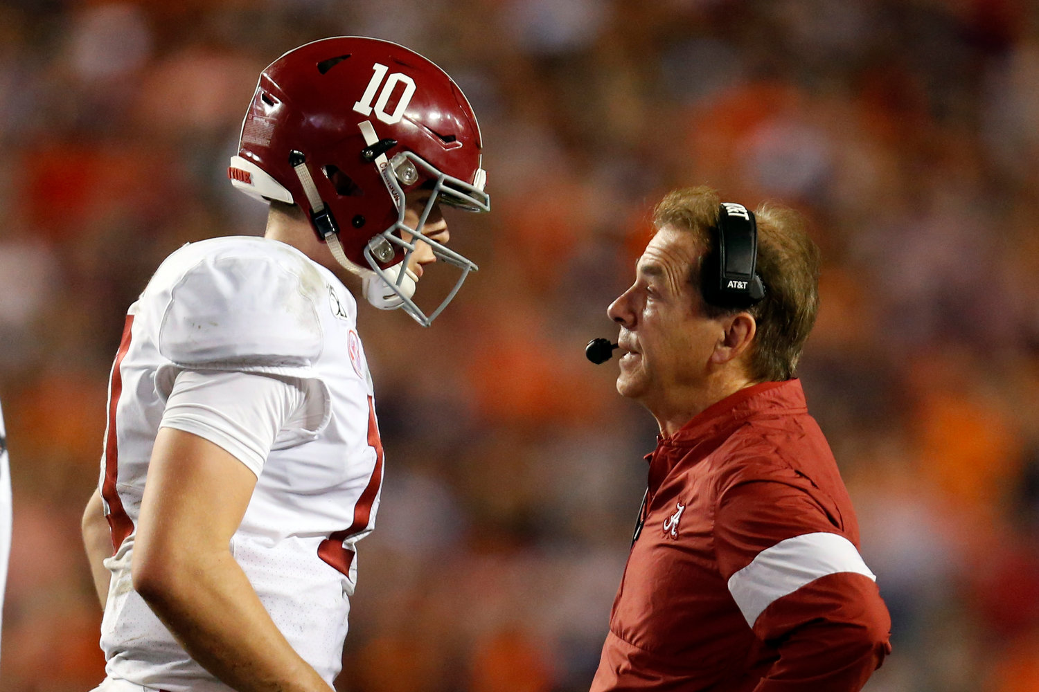 Alabama quarterback Mac Jones (10) talks with head coach Nick Saban during the second half of an NCAA college football game against Auburn, Saturday, Nov. 30, 2019, in Auburn, Ala. Auburn won 48-45. (AP Photo/Butch Dill)