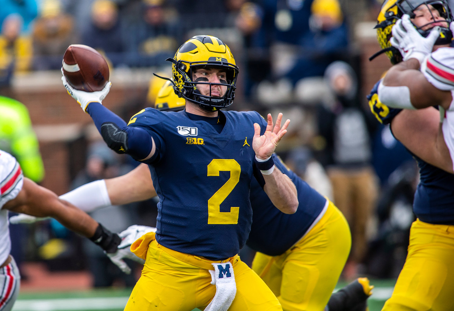 Michigan quarterback Shea Patterson (2) throws a pass in the first quarter of an NCAA college football game against Ohio State in Ann Arbor, Mich., Saturday, Nov. 30, 2019. (AP Photo/Tony Ding)
