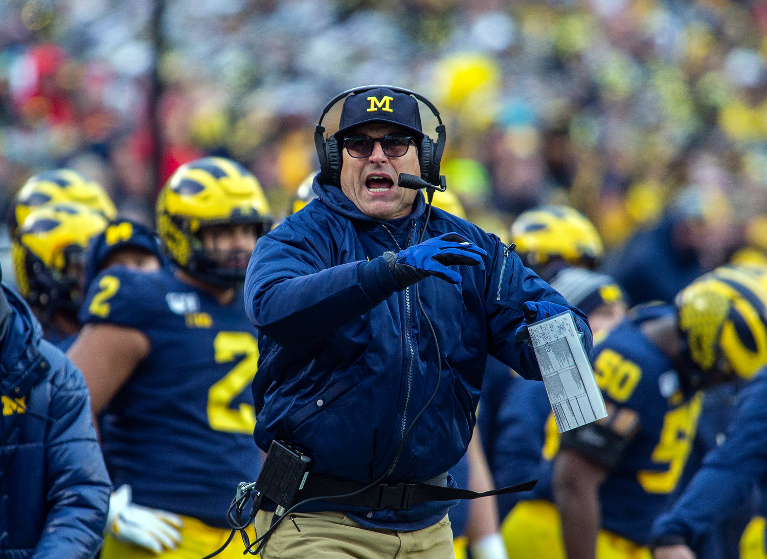 Michigan head coach Jim Harbaugh calls a timeout from the sidelines in the third quarter of an NCAA college football game against Ohio State in Ann Arbor, Mich., Saturday, Nov. 30, 2019. Ohio State won 56-27. (AP Photo/Tony Ding)